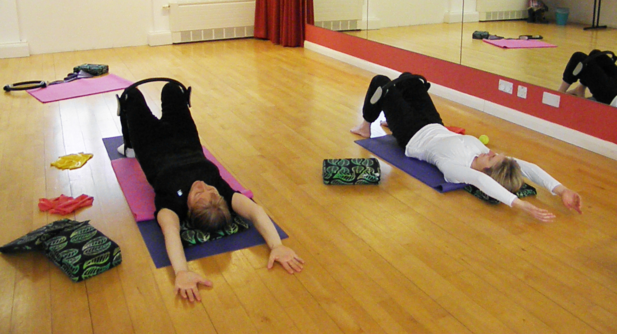 Spine curls with the Pilates circle. East Bristol