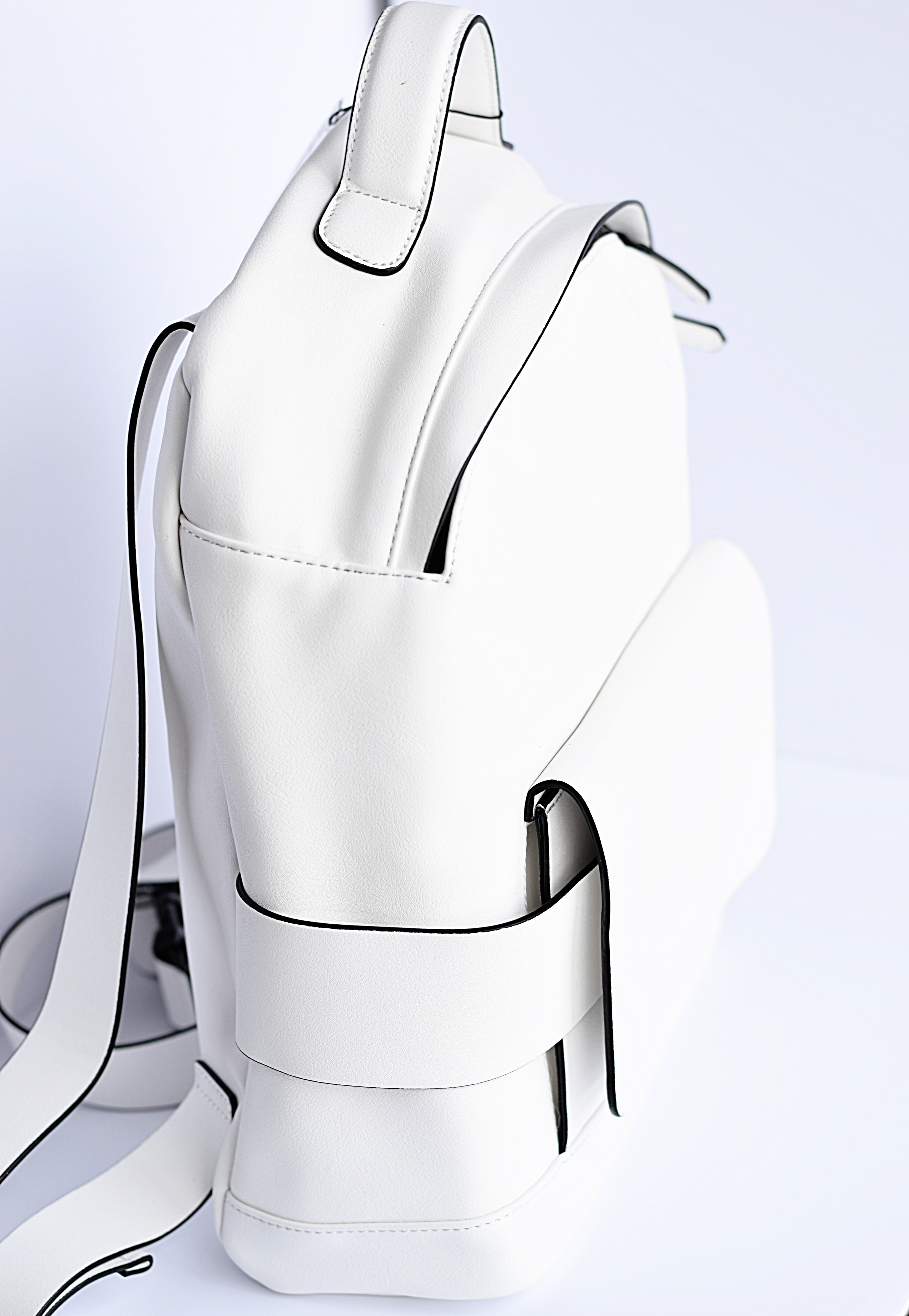 white faux leather backpack