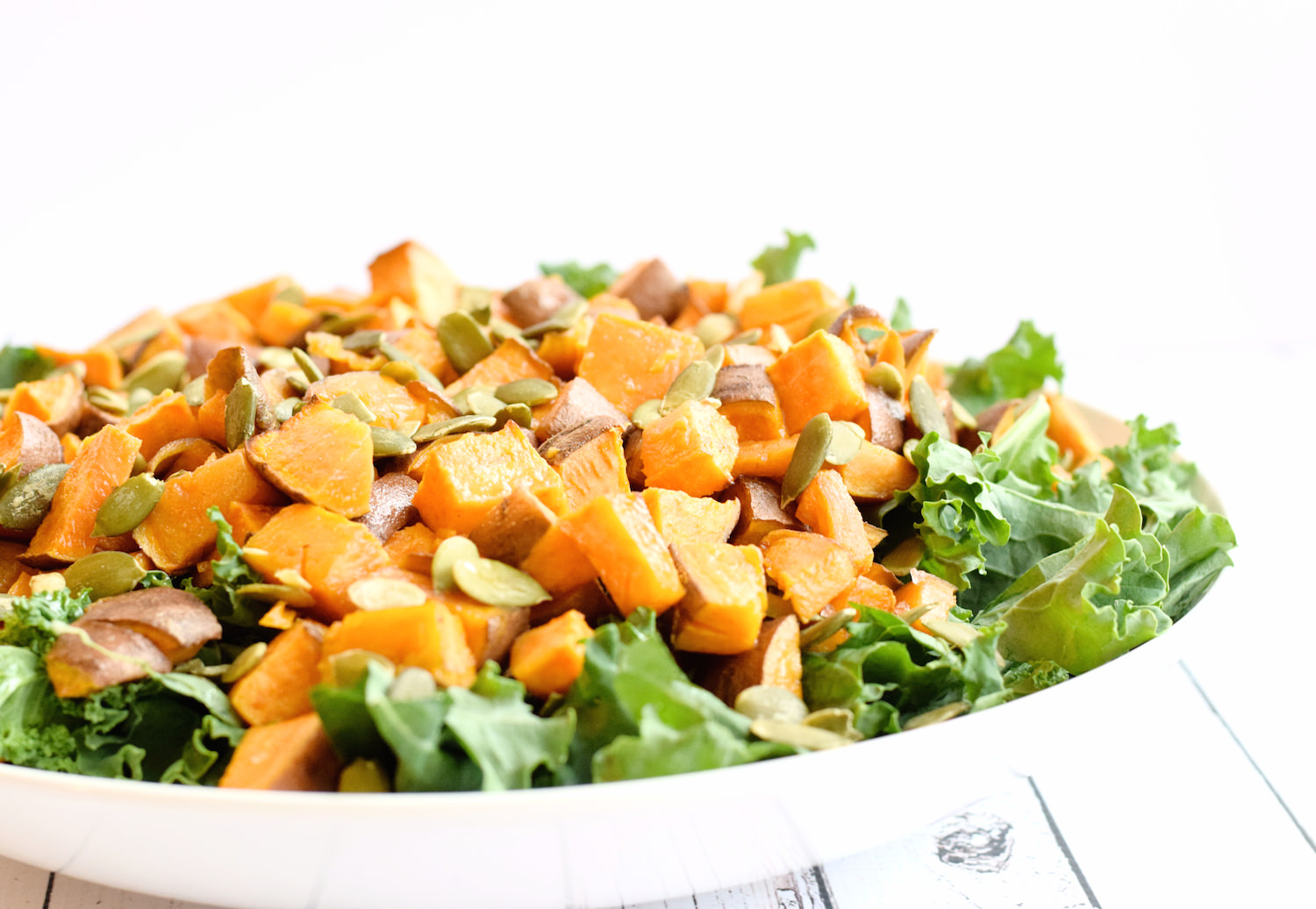 Kale Sweet Potato Tahini Salad – easy, delicious, wholesome, flavorful kale salad with a perfect tahini dressing. My new favorite salad!   trufflesandtrends.com