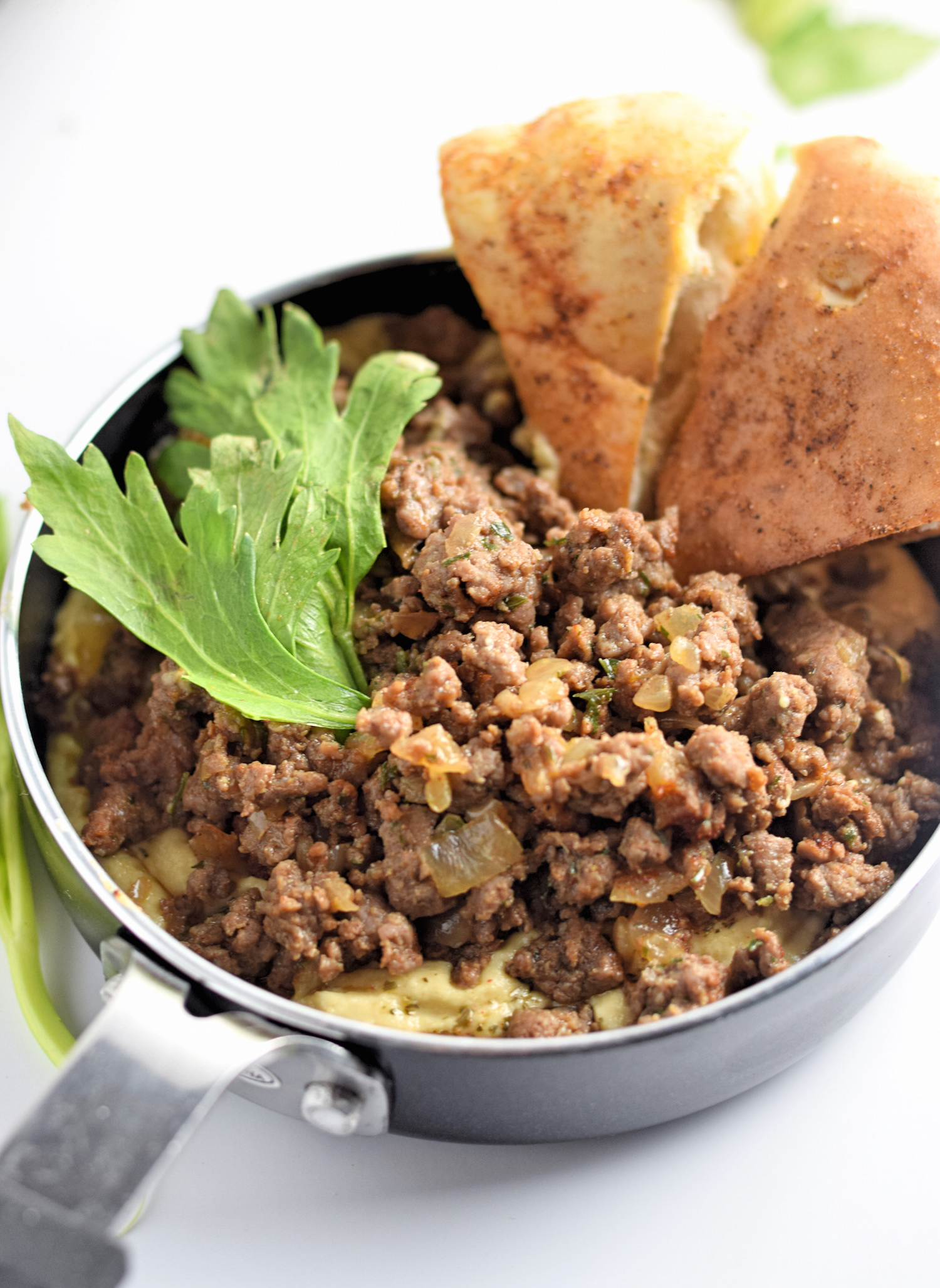 Ground Beef with Hummus and Pita Chips: chopped meat flavored with Middle Eastern Spices, served with hummus and homemade pita chips. Perfect Super Bowl dish! | TrufflesandTrends.com