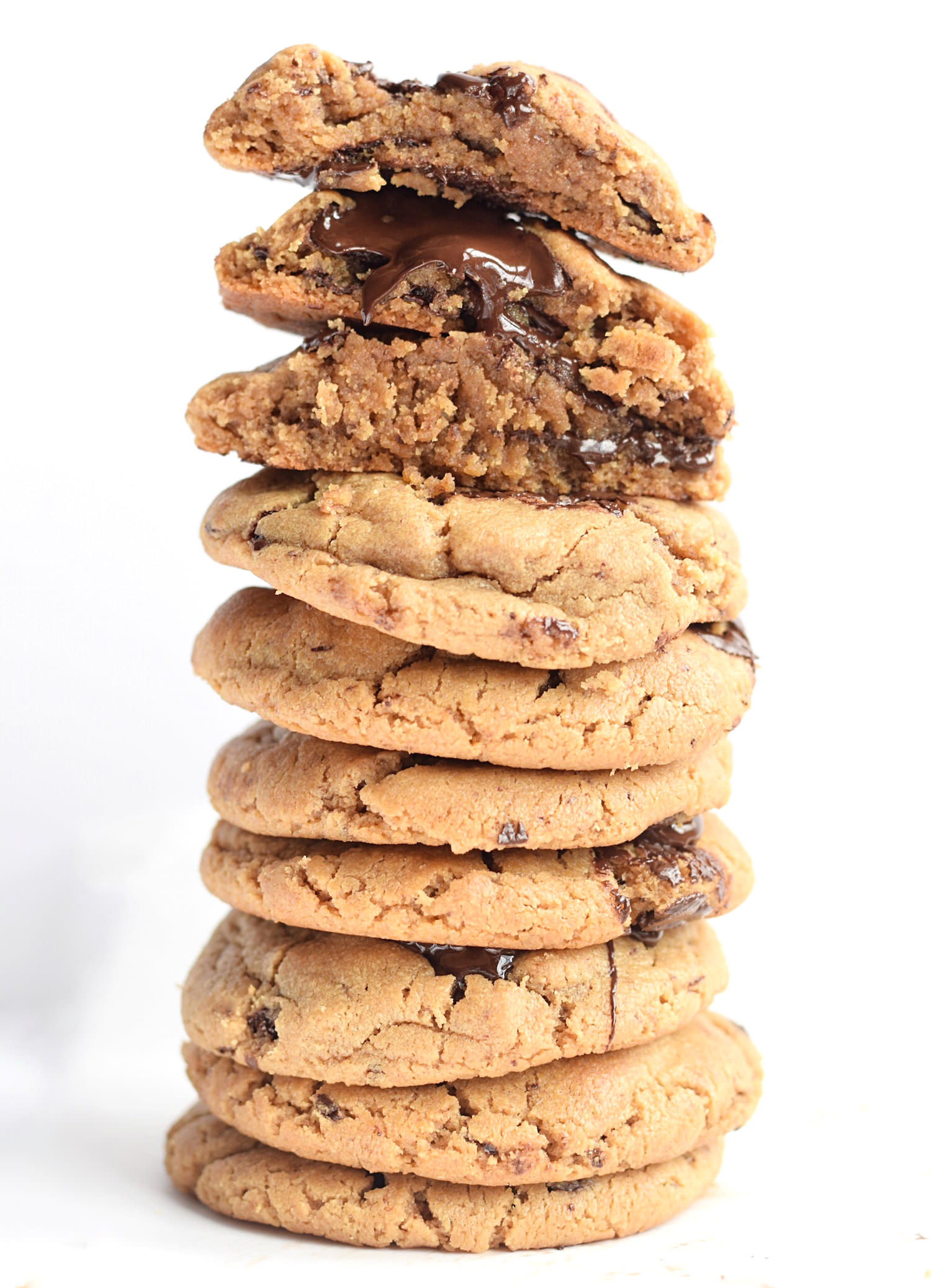 Flourless Peanut Butter Chocolate Chip Cookies: soft, thick, chewy, and gooey and packed with rich peanut butter flavor and chocolate chunks. Best peanut butter cookies! | TrufflesandTrends.com