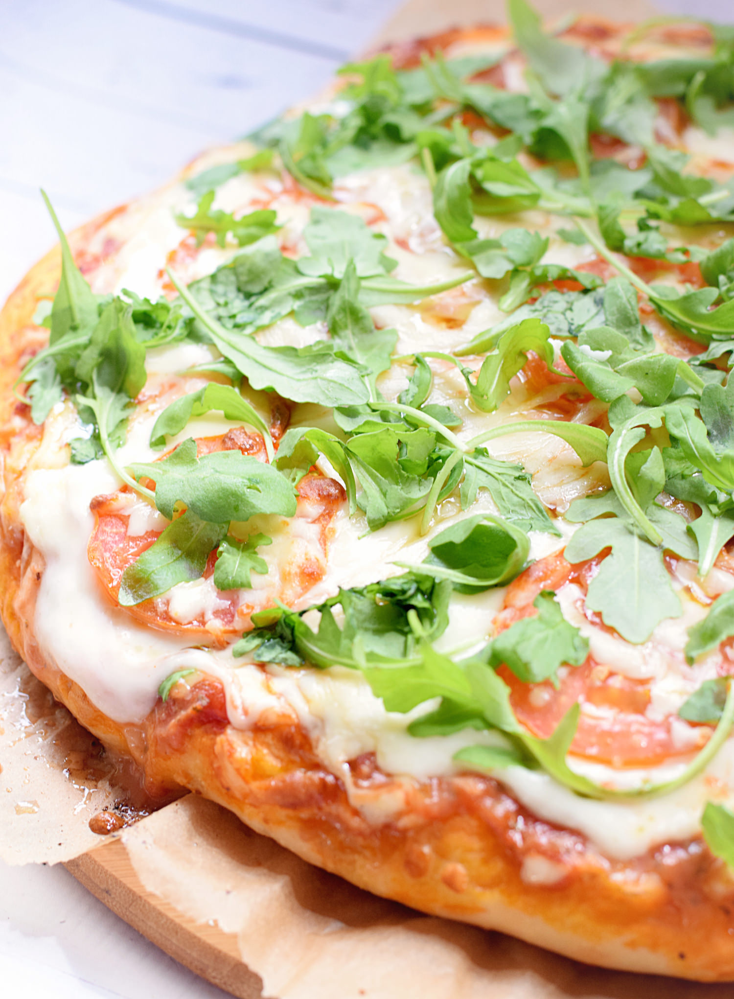 Favorite Homemade Pizza: soft and chewy pizza crust, flavorful tomato sauce, and your favorite cheese and toppings. Best homemade pizza! | TrufflesandTrends.com