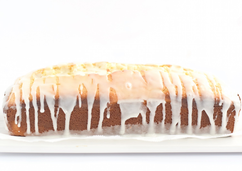 Soft and Moist Lemon Loaf: one bowl, soft, moist lemon loaf full of lemon flavor and drizzled with a tangy lemon glaze. Starbucks copycat!   TrufflesandTrends.com