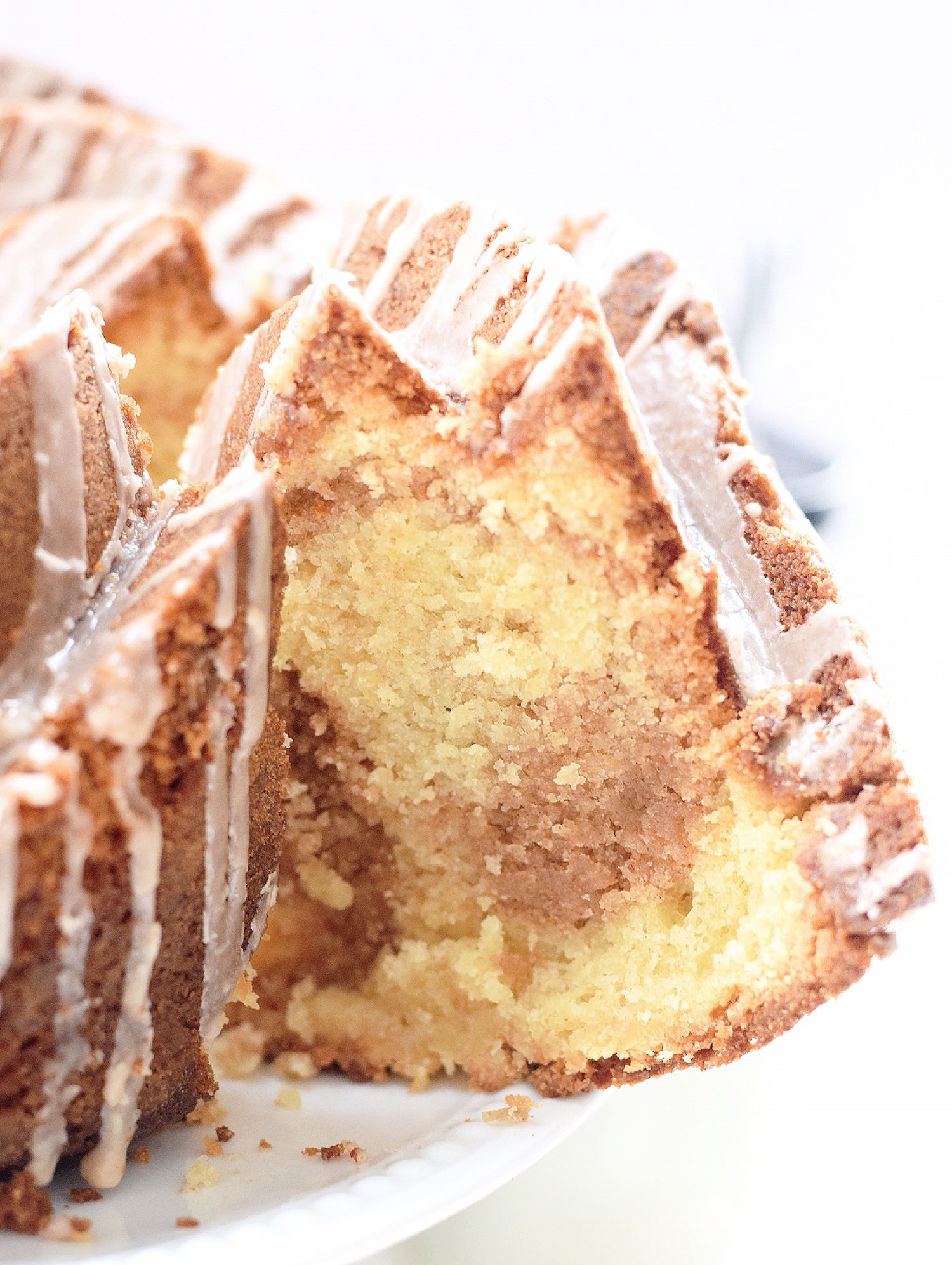 Cinnamon Swirl Bundt Cake: one bowl, moist, tender vanilla Bundt cake with cinnamon swirls. Quick, easy and completely non-dairy! | TrufflesandTrends.com