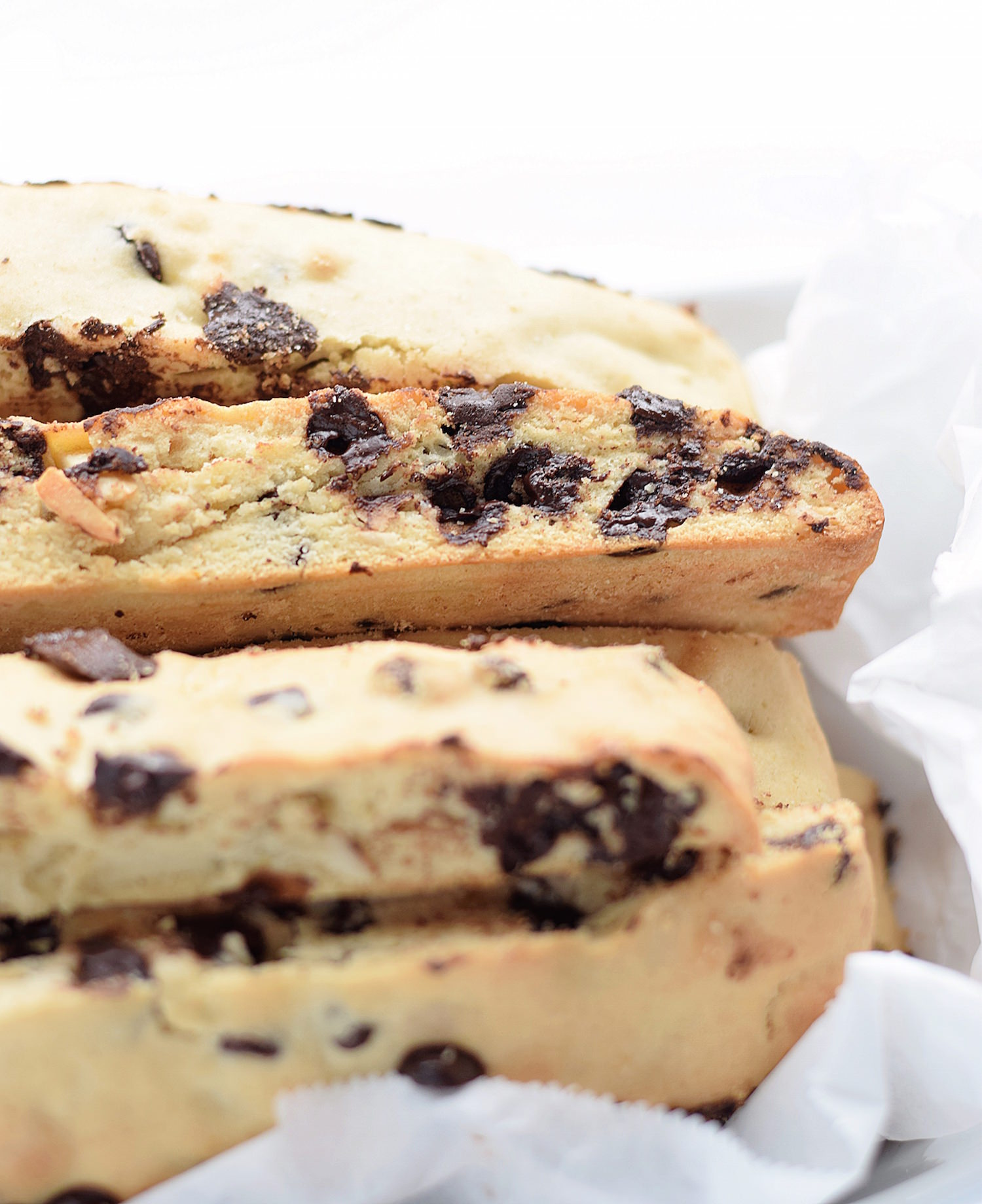 Easy Chocolate Chip Almond Biscotti: easiest, most tender biscotti packed with chocolate chips and slivered almonds. Made in minutes in one bowl! | TrufflesandTrends.com