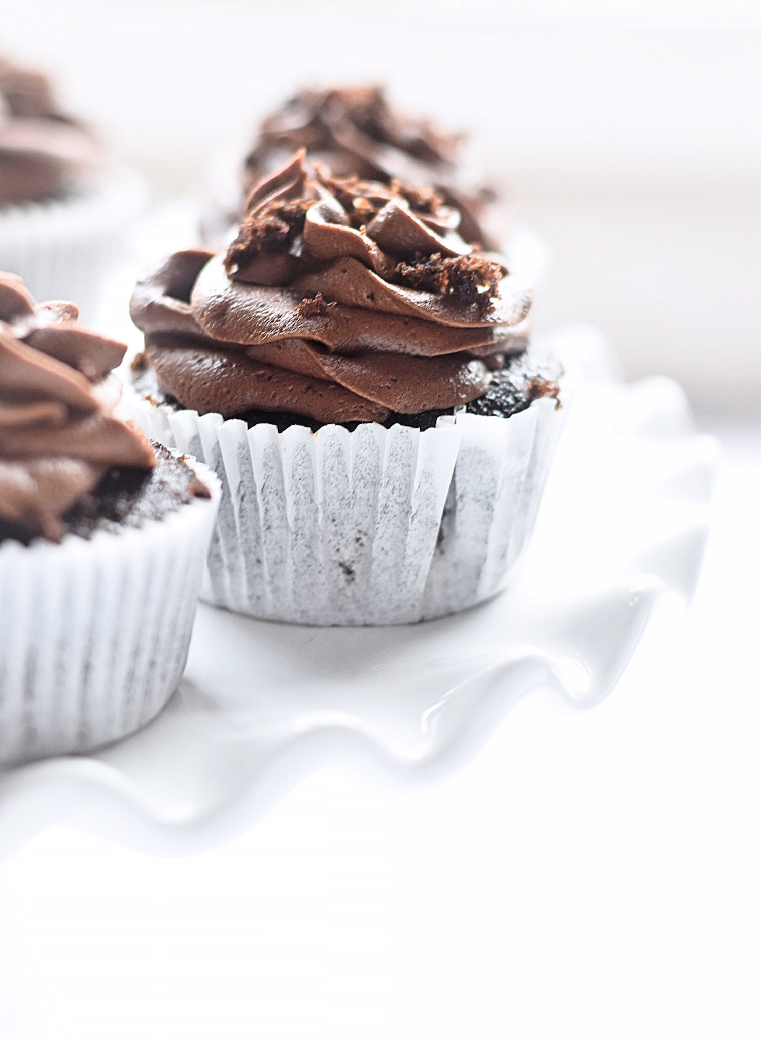 These Amazing Chocolate Cupcakes with Chocolate Buttercream Frosting are soft, tender, perfectly sweet, and full of rich chocolate flavor. | TrufflesandTrends.com