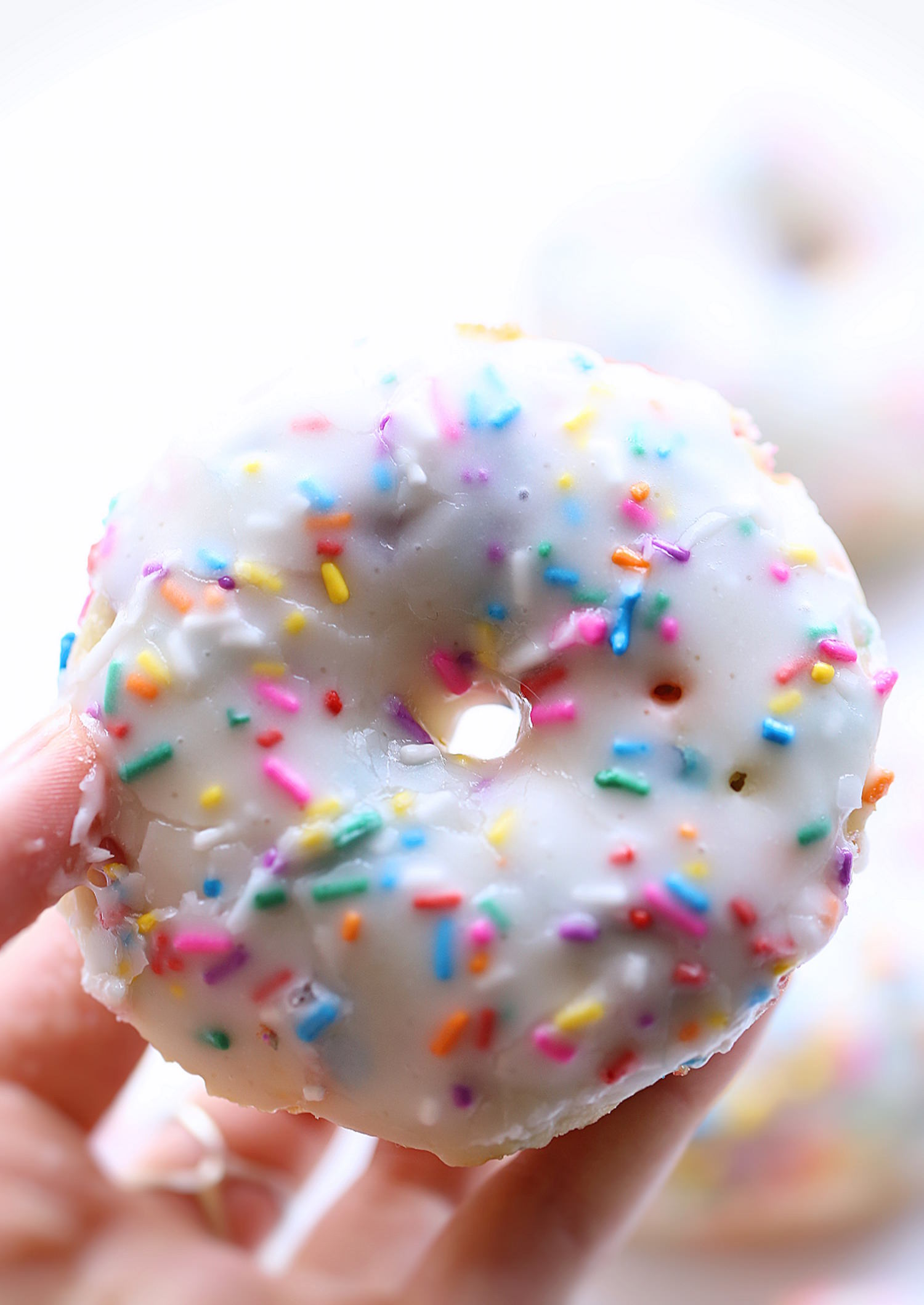 Baked Funfetti Donuts: soft, fluffy baked donuts packed with sprinkles and topped with a vanilla glaze. So easy and delicious! | TrufflesandTrends.com