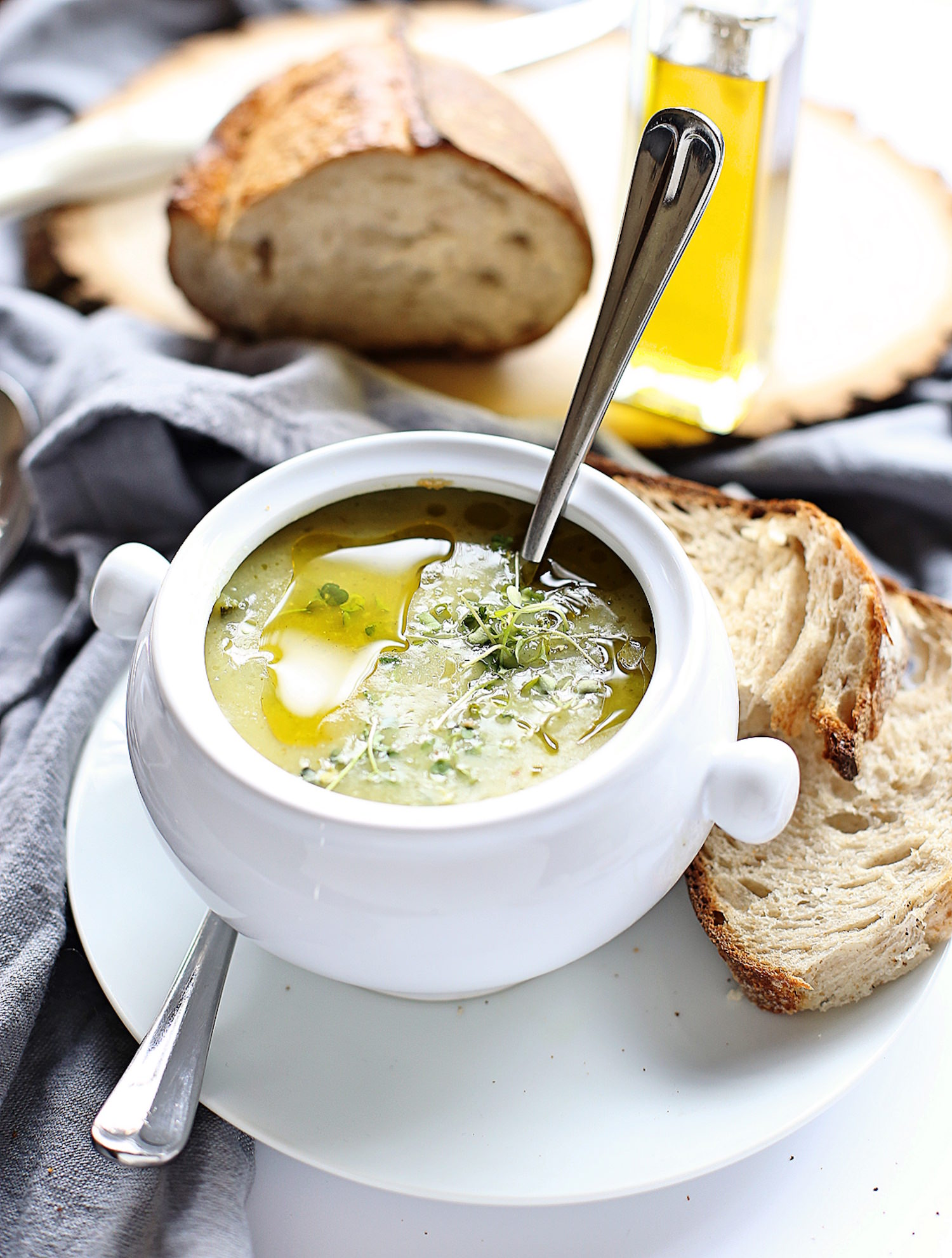 Quick and Easy Zucchini Soup: zucchinis, onions, and a few other ingredients come together to form this creamy, wholesome, delicious soup.   TrufflesandTrends.com