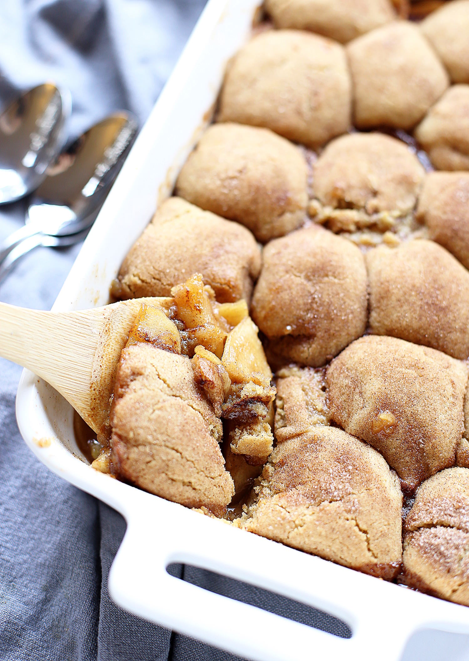 Caramel Apple Snickerdoodle Cobbler: brown butter, caramelized apple mixture topped with the best snickerdoodle cookies. One epic cobbler! | TrufflesandTrends.com
