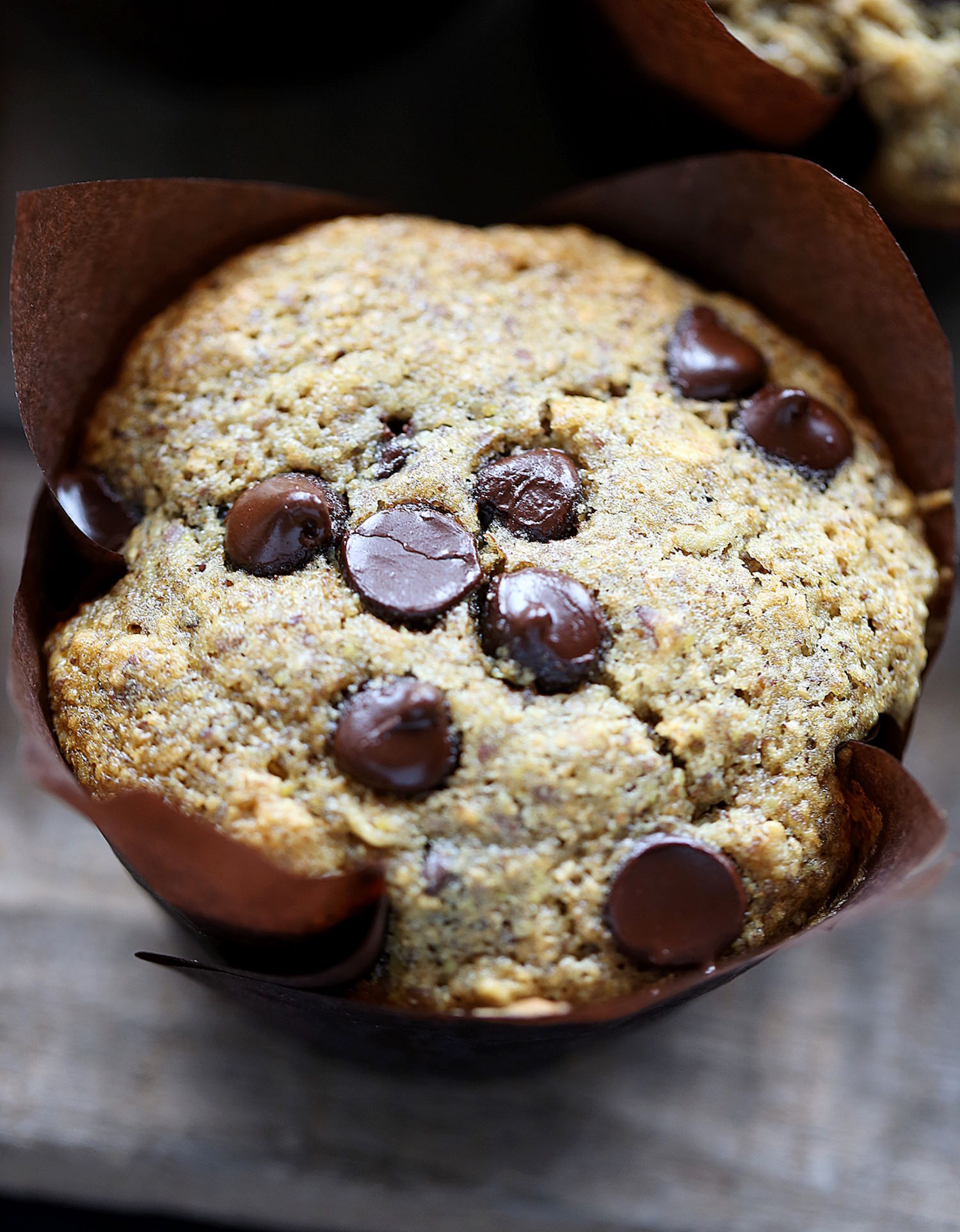 Whole Wheat Oatmeal Flax Chocolate Chip Muffins: soft, fluffy, wholesome muffins make the perfect breakfast or snack. Easy and delicious! | TrufflesandTrends.com