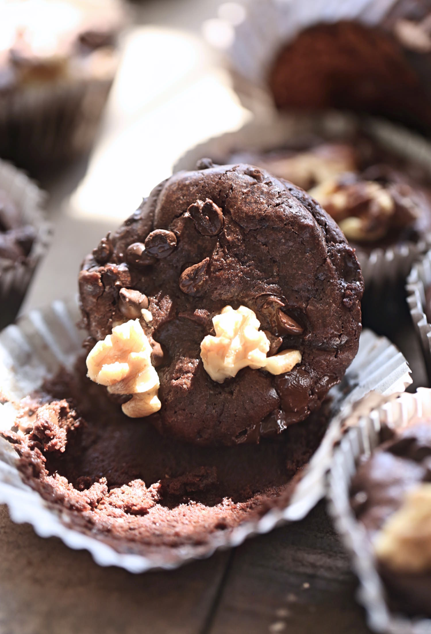 Rich Brownie Muffins: dense, fudgy, one bowl, rich chocolate brownie muffins studded with walnuts and chocolate chips. Video included! | TrufflesandTrends.com