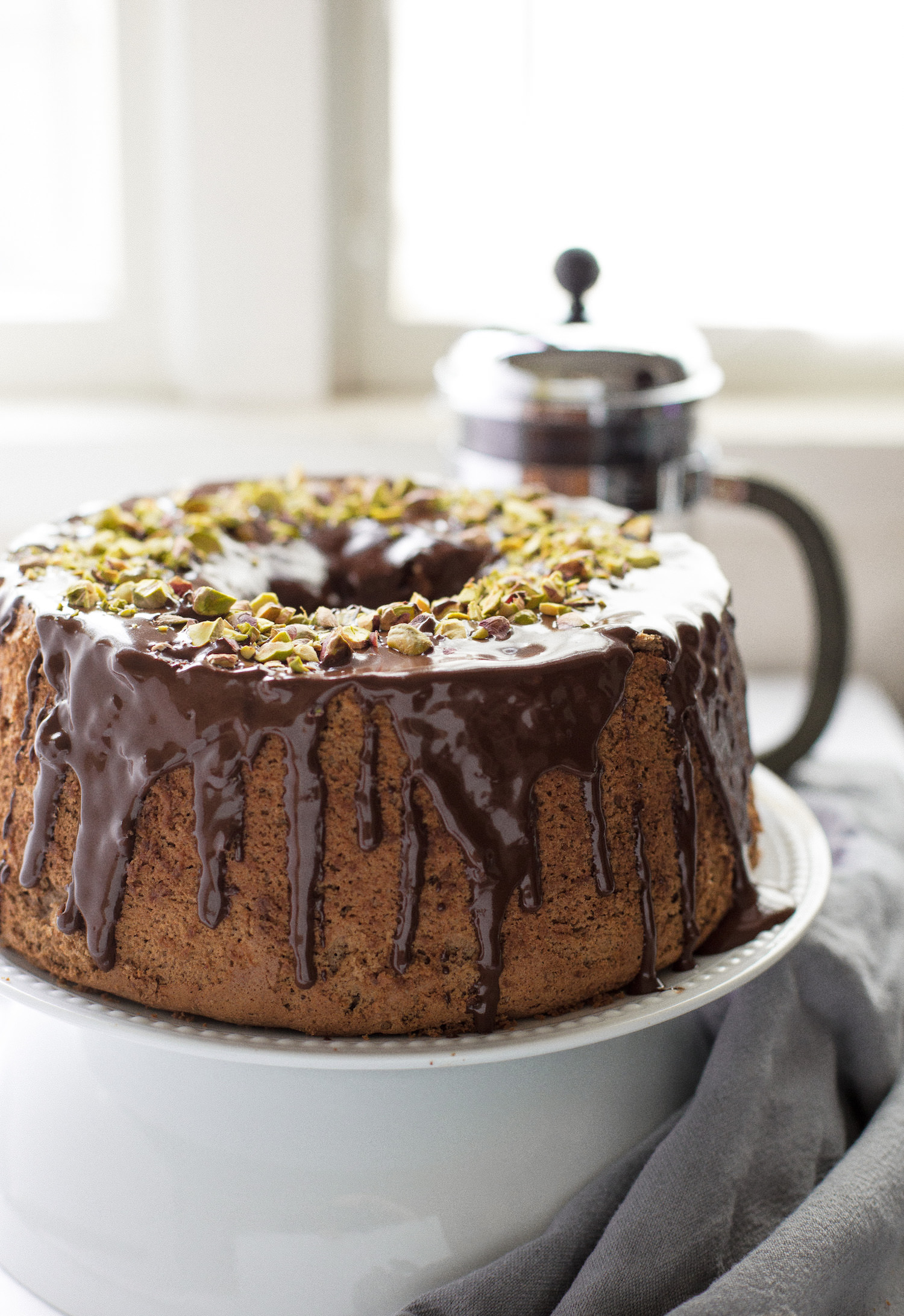 Chocolate Chiffon Cake with Ganache Glaze: fluffy, airy, light chocolate cake topped with a rich, creamy, chocolate ganache. | TrufflesandTrends.com