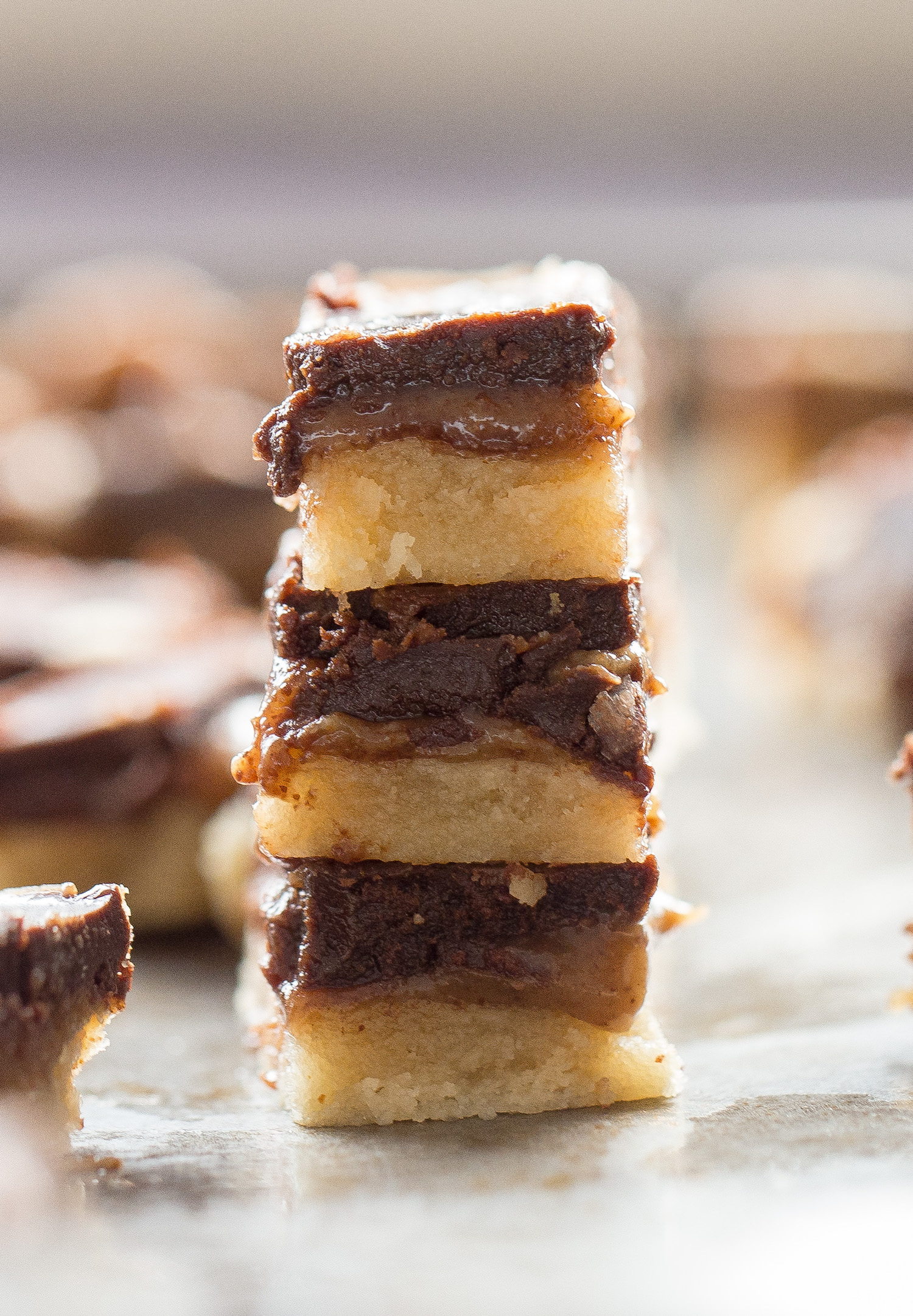 Wholesome Caramel Chocolate Shortbread Bars: chewy shortbread crust, rich caramel filling, and creamy chocolate. Grain free, sugar free, vegan! Video included. | TrufflesandTrends.com