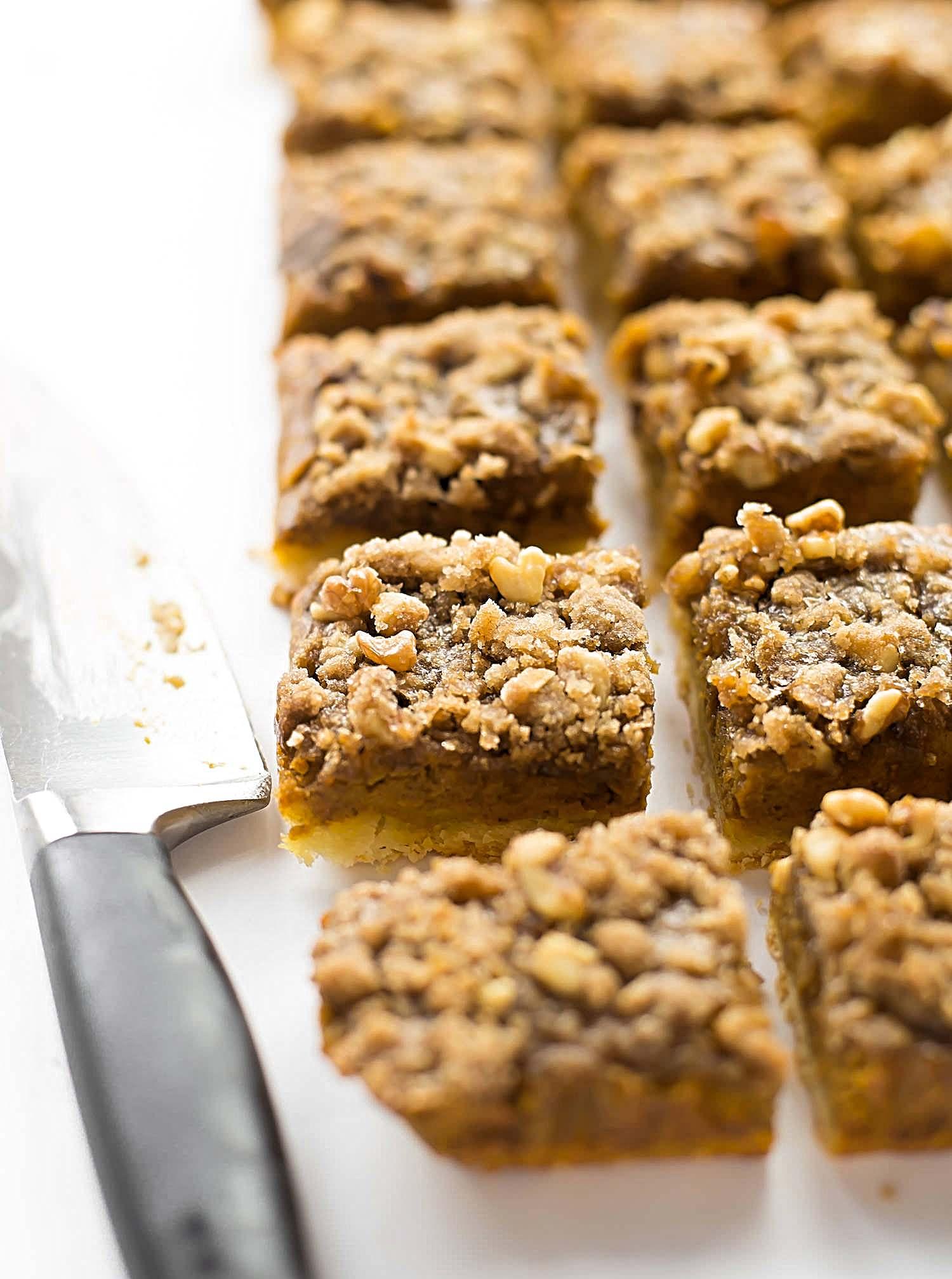 Pumpkin Pie Streusel Bars: buttery shortbread crust, creamy pumpkin filling, and a cinnamon streusel on top. Thanksgiving dessert perfection! | TrufflesandTrends.com
