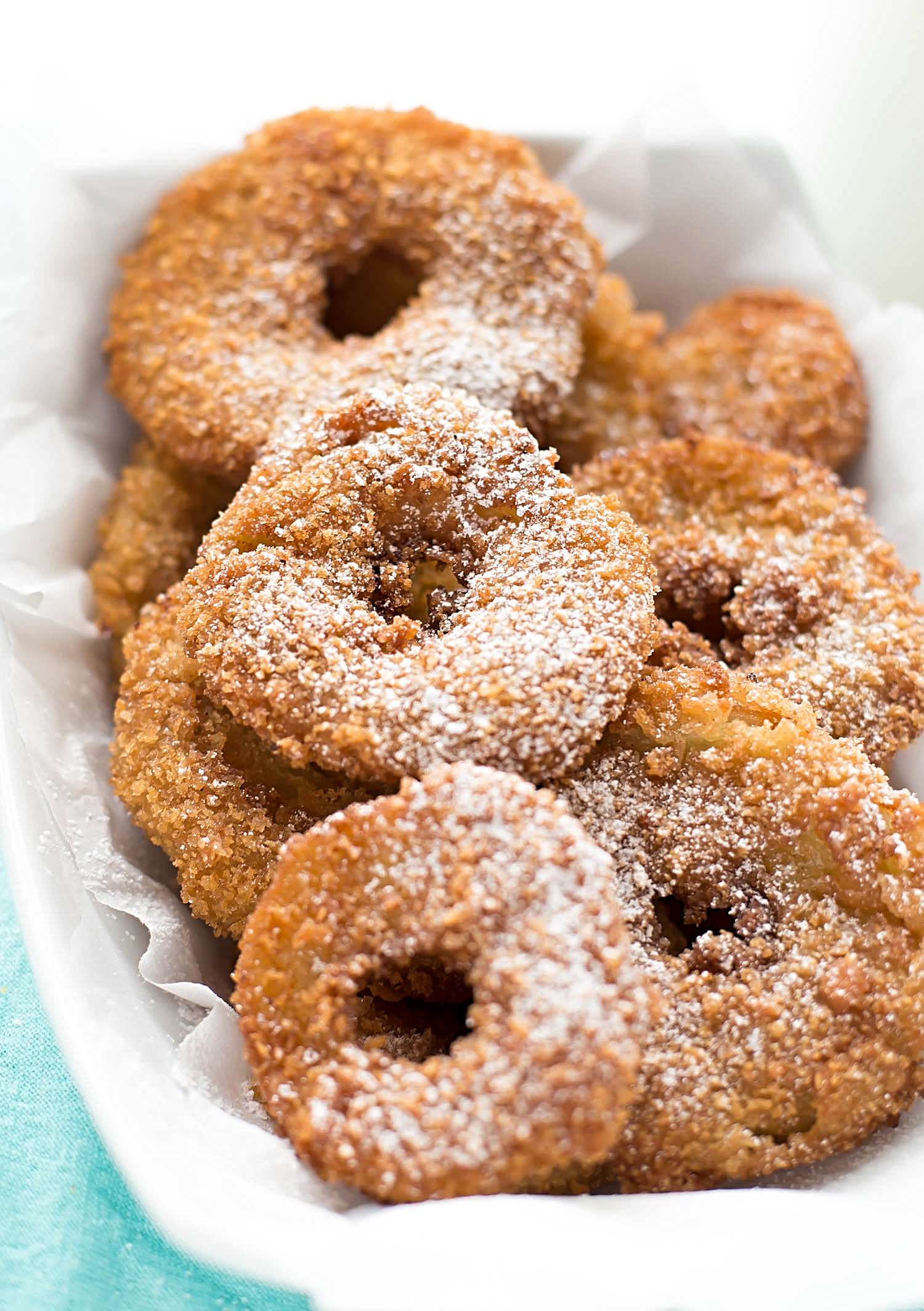 Deep-Fried Crispy Apple Donuts: apple rings dipped in a sweet cinnamony batter and crispy panko crumbs then deep-fried to crunchy perfection. | TrufflesandTrends.com