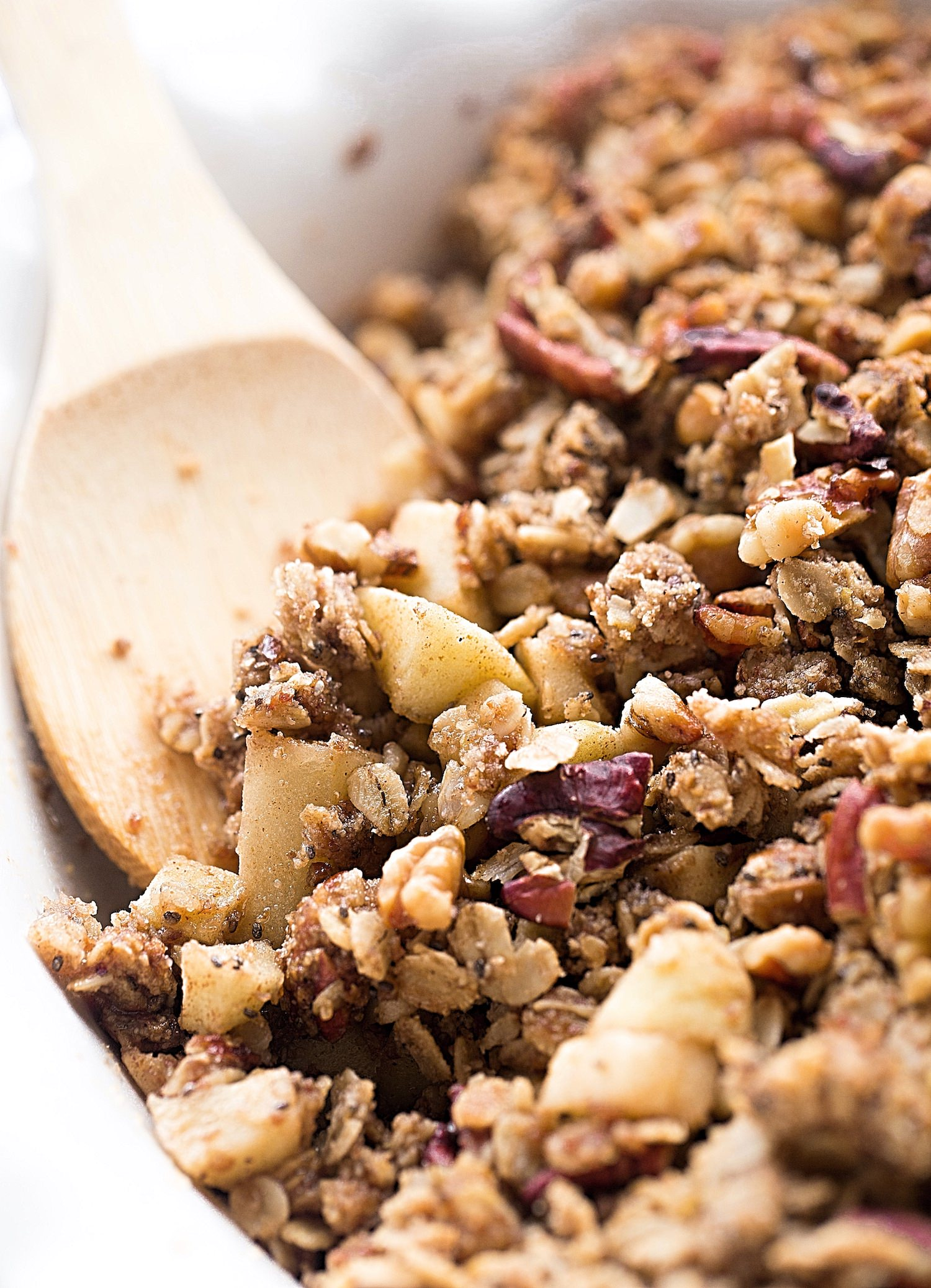 Wholesome Nutty Apple Crumble: tart apples topped with a nutty, cinnamon oat crumble. Gluten-free, vegan, and nutrient dense! Video included. | TrufflesandTrends.com