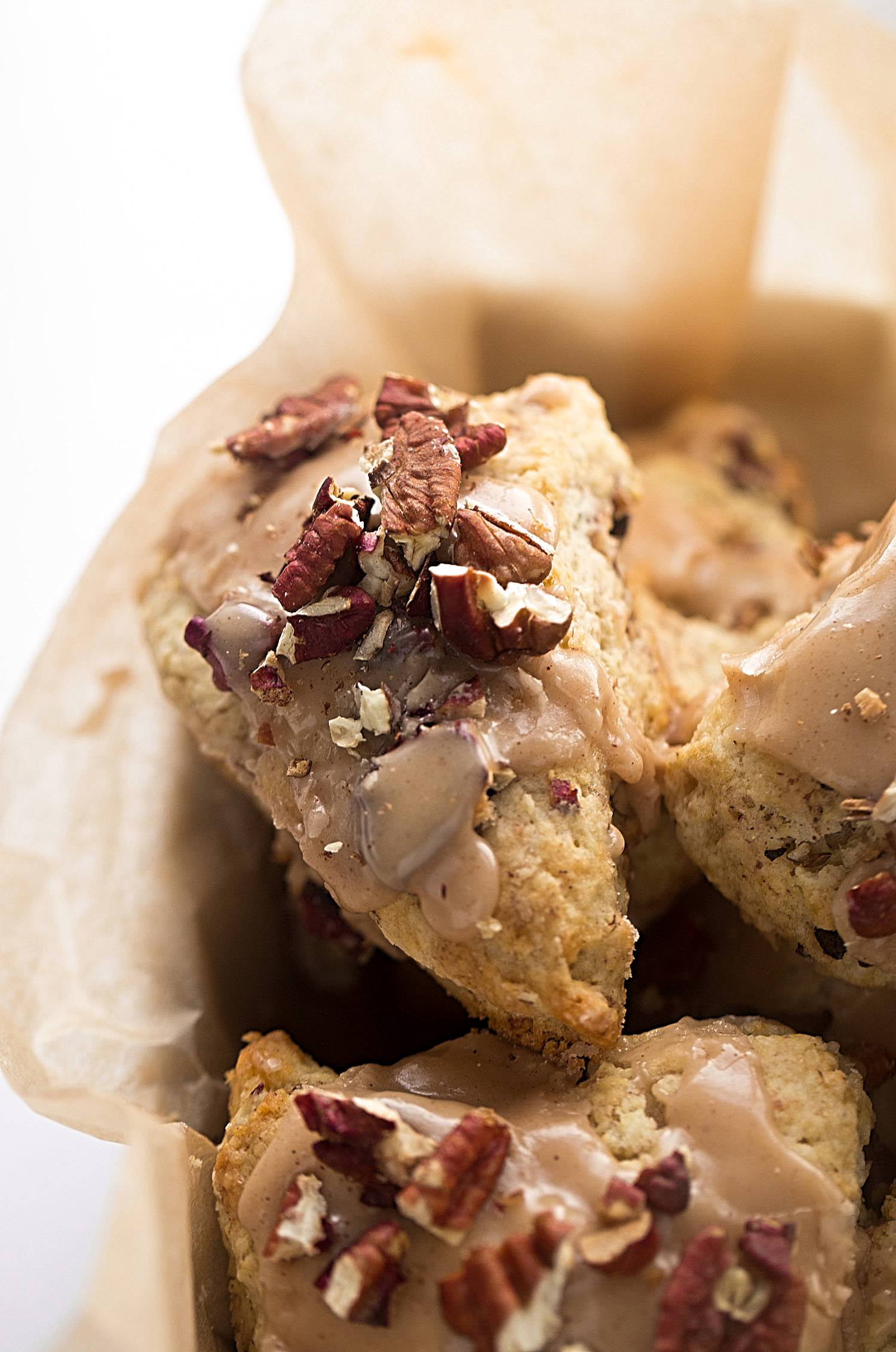 Maple Glazed Cinnamon Pecan Scones: tender, buttery scones filled with toasted pecans and topped with a maple-cinnamon glaze. | TrufflesandTrends.com