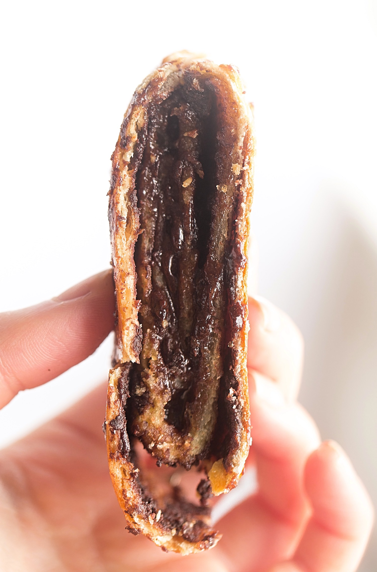 Better than Babka: Kokosh Cake - thin layers of no-rise yeast dough stuffed with an oozing, gooey chocolate filling. So quick and rich! | TrufflesandTrends.com
