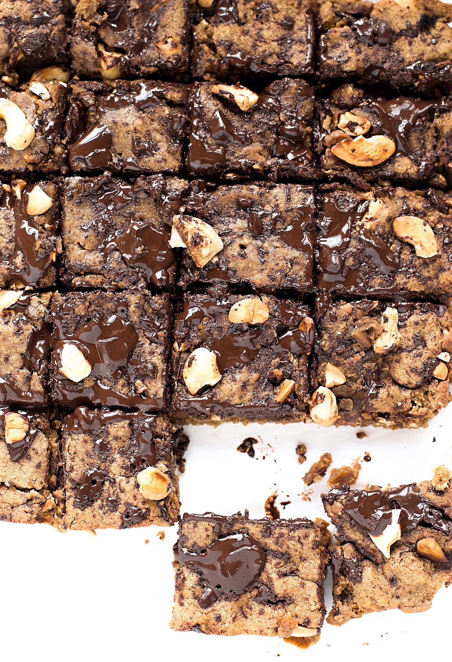 Chocolate Chip Cashew Nut Butter Bars: soft, gooey, rich bars made with coconut oil, nut butter, chocolate chunks, and toasted cashews. | TrufflesandTrends.com
