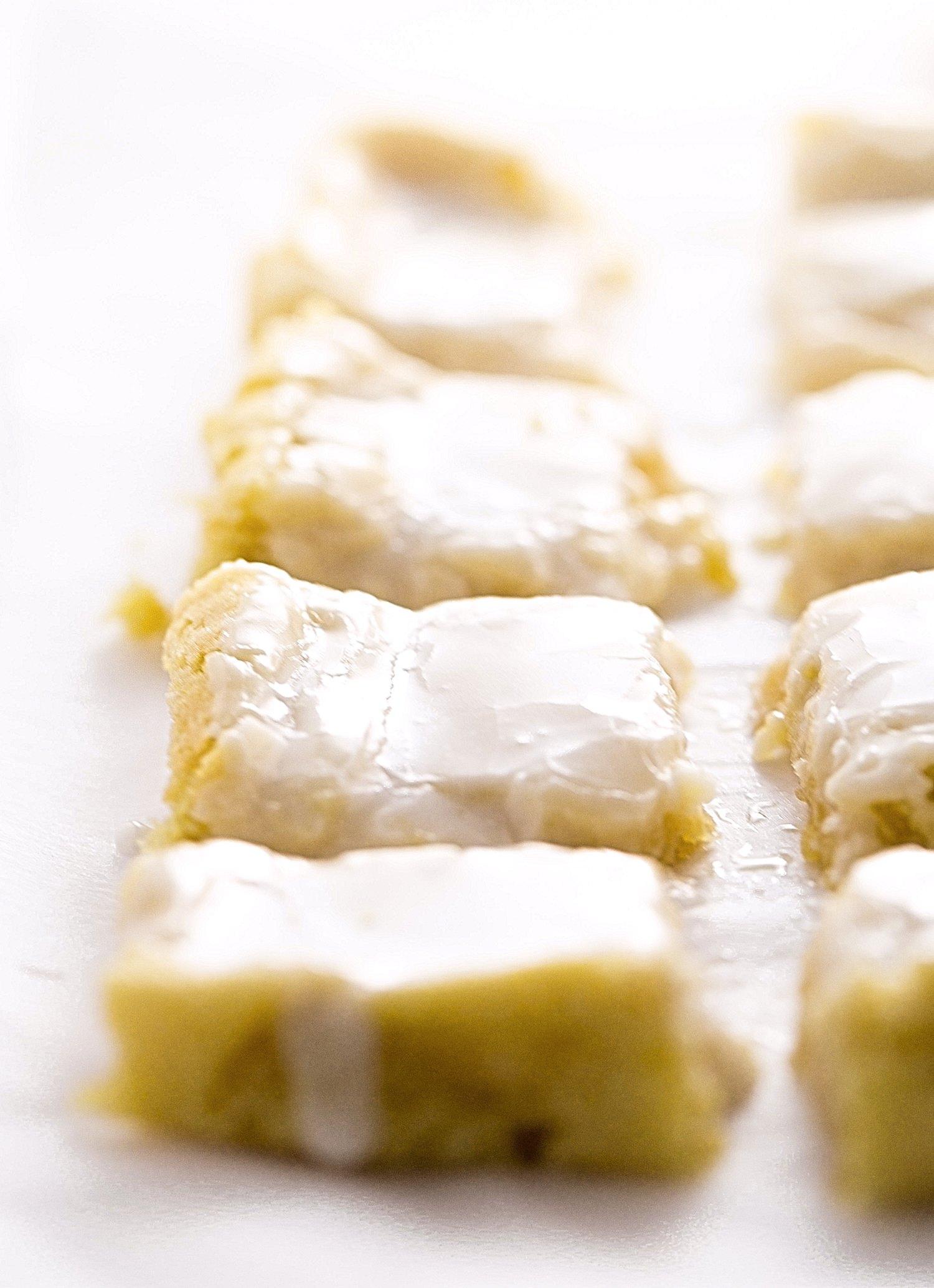 No-Butter Glazed Lemon Blondies: soft, gooey, rich lemon blondies, or lemonies. Made with coconut oil and a tangy lemon glaze. So easy!