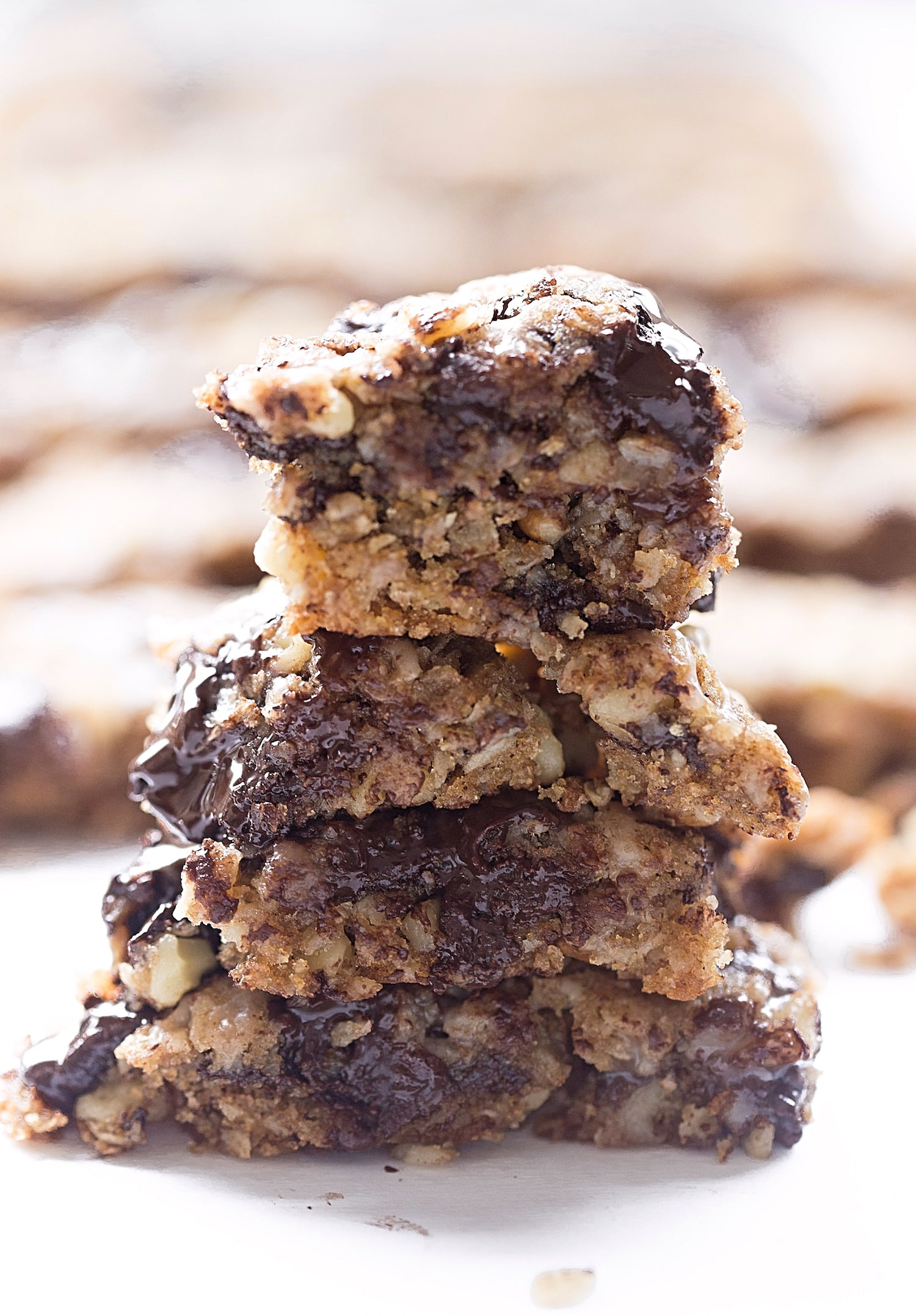 Whole Wheat Oatmeal Chocolate Chip Walnut Bars: soft, chewy, gooey, hearty oatmeal bars packed with chocolate chunks and walnuts. Video included! | TrufflesandTrends.com
