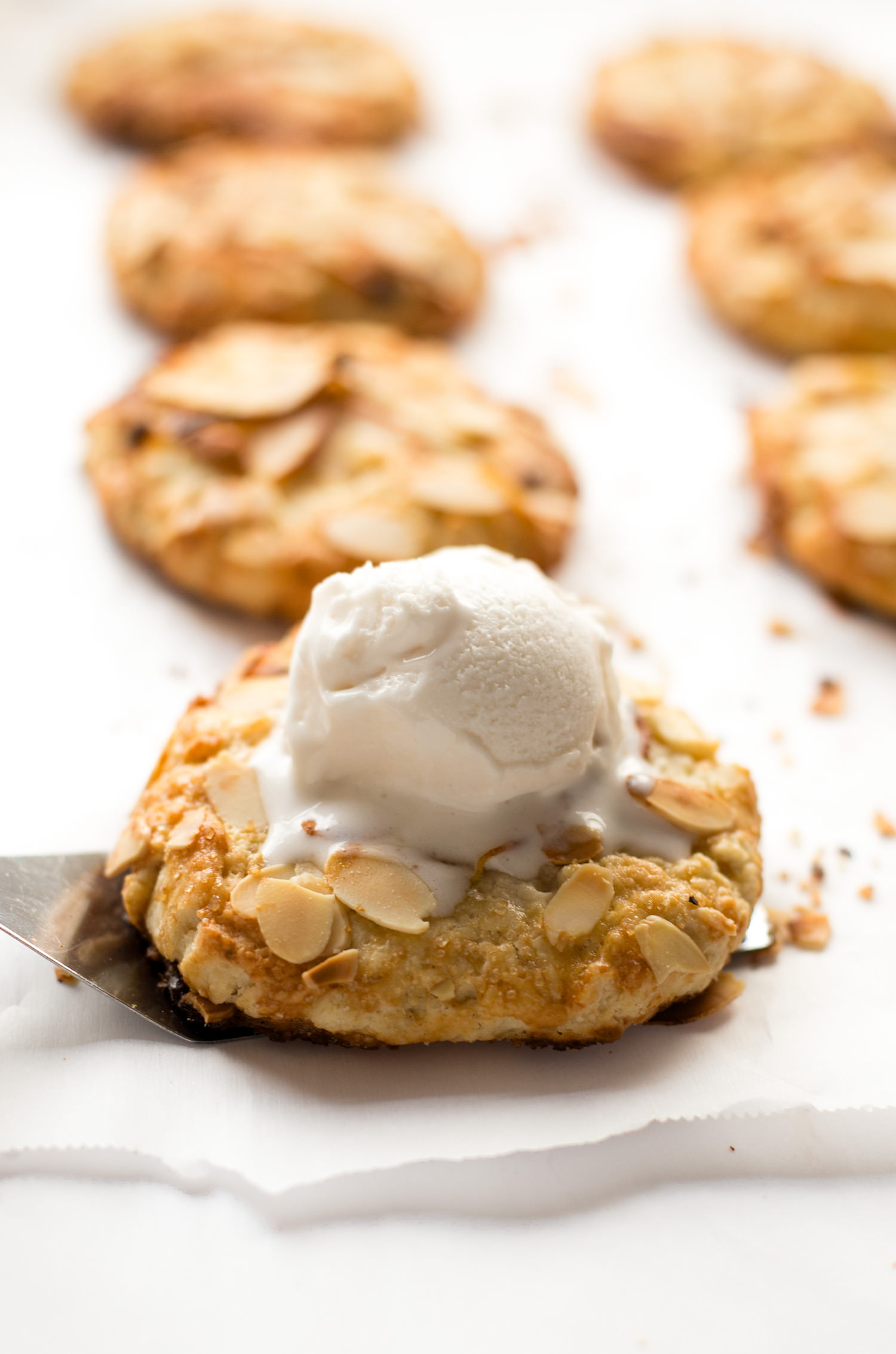 Mini Almond Pear Galettes: beautiful, mini galettes spread with an almond filling, filled with juicy pears, and topped with slivered almonds. | TrufflesandTrends.com