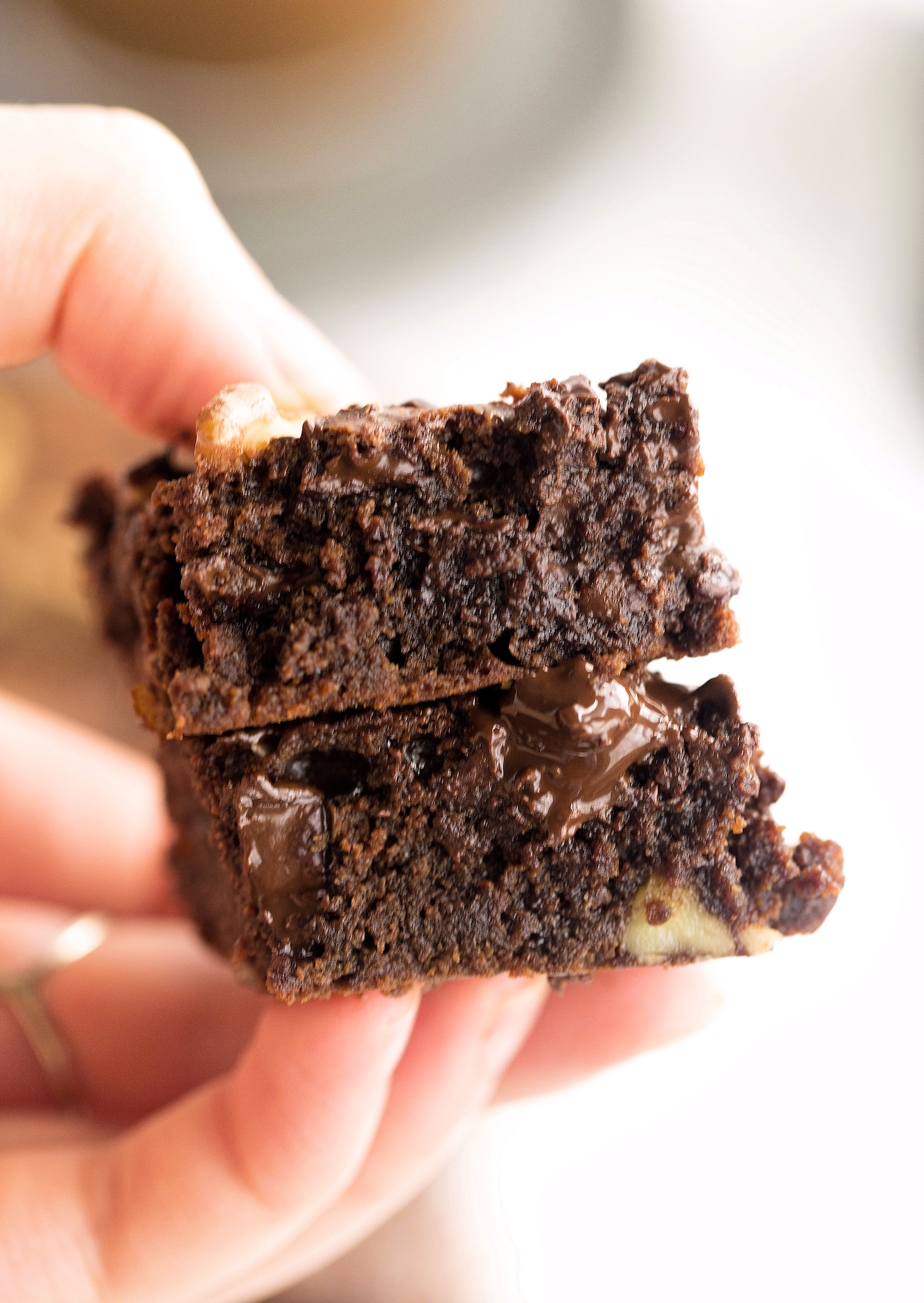 Wholesome Flourless Tahini Brownies: easy, quick, rich, gooey brownies made without dairy, refined sugar, oil, or gluten. Too good!   TrufflesandTrends.com