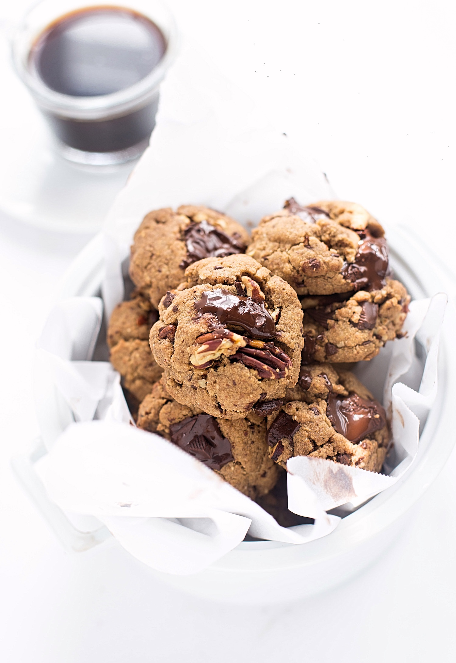 Wholesome(ish) Nut Butter Chocolate Chip Cookies: soft, chewy, rich whole wheat cookies made with nut butter, coconut oil, chocolate chunks, and chopped nuts. | TrufflesandTrends.com