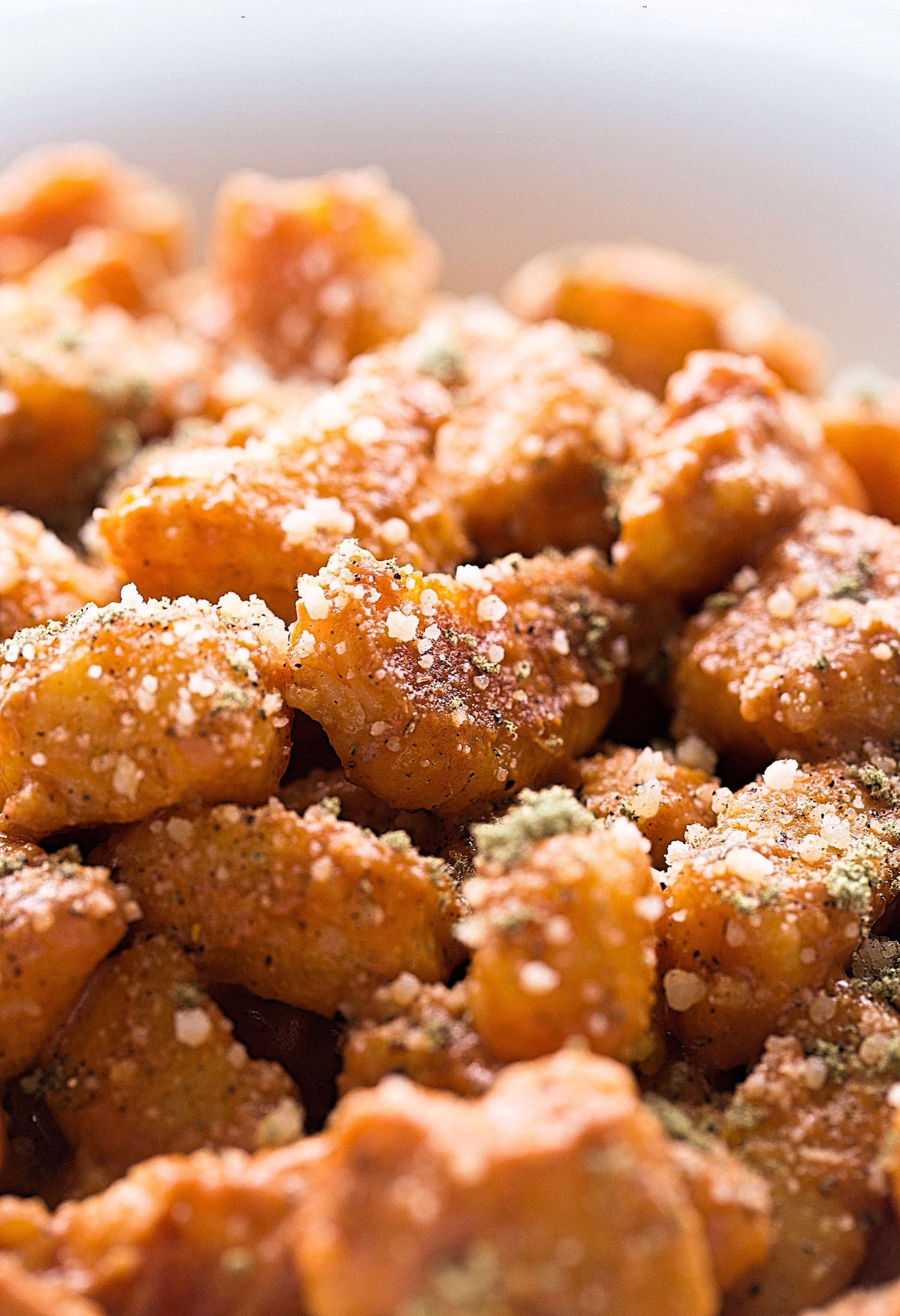 Sweet Potato Gnocchi with Tomato Cream Sauce: soft, pillowy, toasted sweet potato gnocchi in an easy tomato cream sauce. Best dinner!   TrufflesandTrends.com