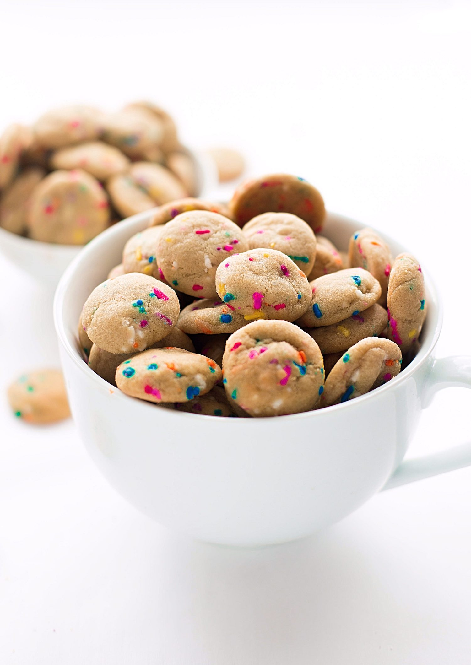 Soft Mini Funfetti Cookies: these one-bite, soft, chewy, sprinkle cookies are so easy to make and even easier to pop into your mouth repeatedly. | TrufflesandTrends.com