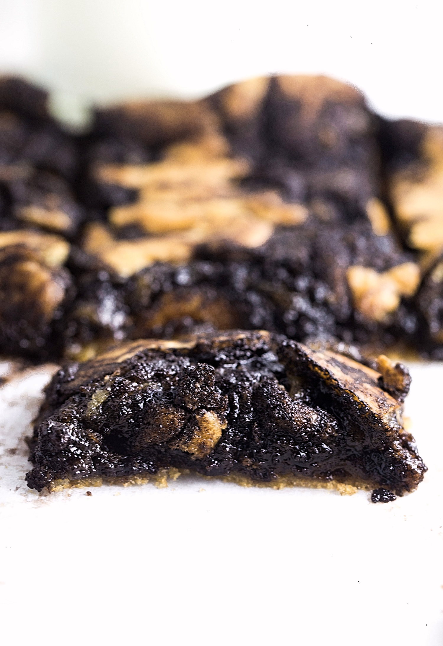Gooey Chocolate Swirled Cookie Bars: soft, rich, cookie dough-like cookie bars with a gooey chocolate mixture swirled through. So easy! | TrufflesandTrends.com