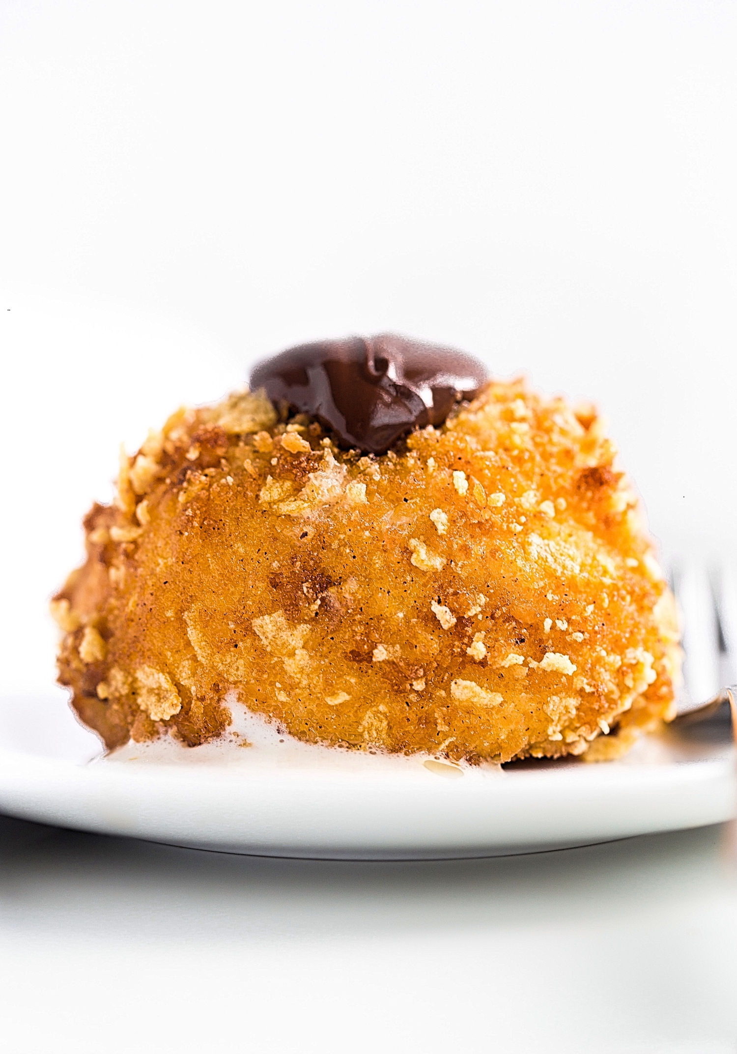 Deep Fried Ice Cream: vanilla ice cream coated in a sweet, crunchy cookie topping, deep-fried for the ultimate hot and cold dessert!   TrufflesandTrends.com