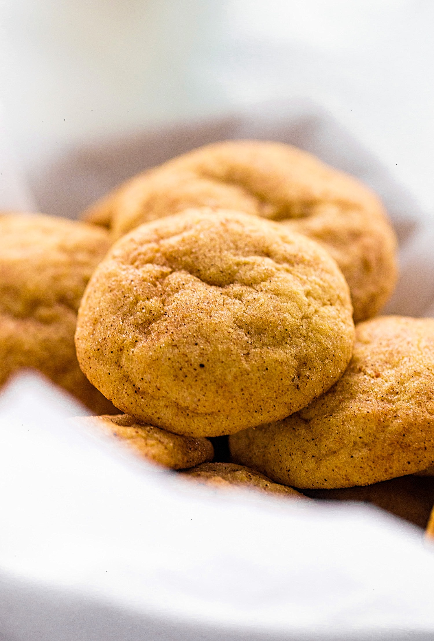 No-Butter Pumpkin Snickerdoodle Cookies: super-soft pumpkin cookies rolled in cinnamon and sugar. One bowl, dairy free, and so good! | TrufflesandTrends.com