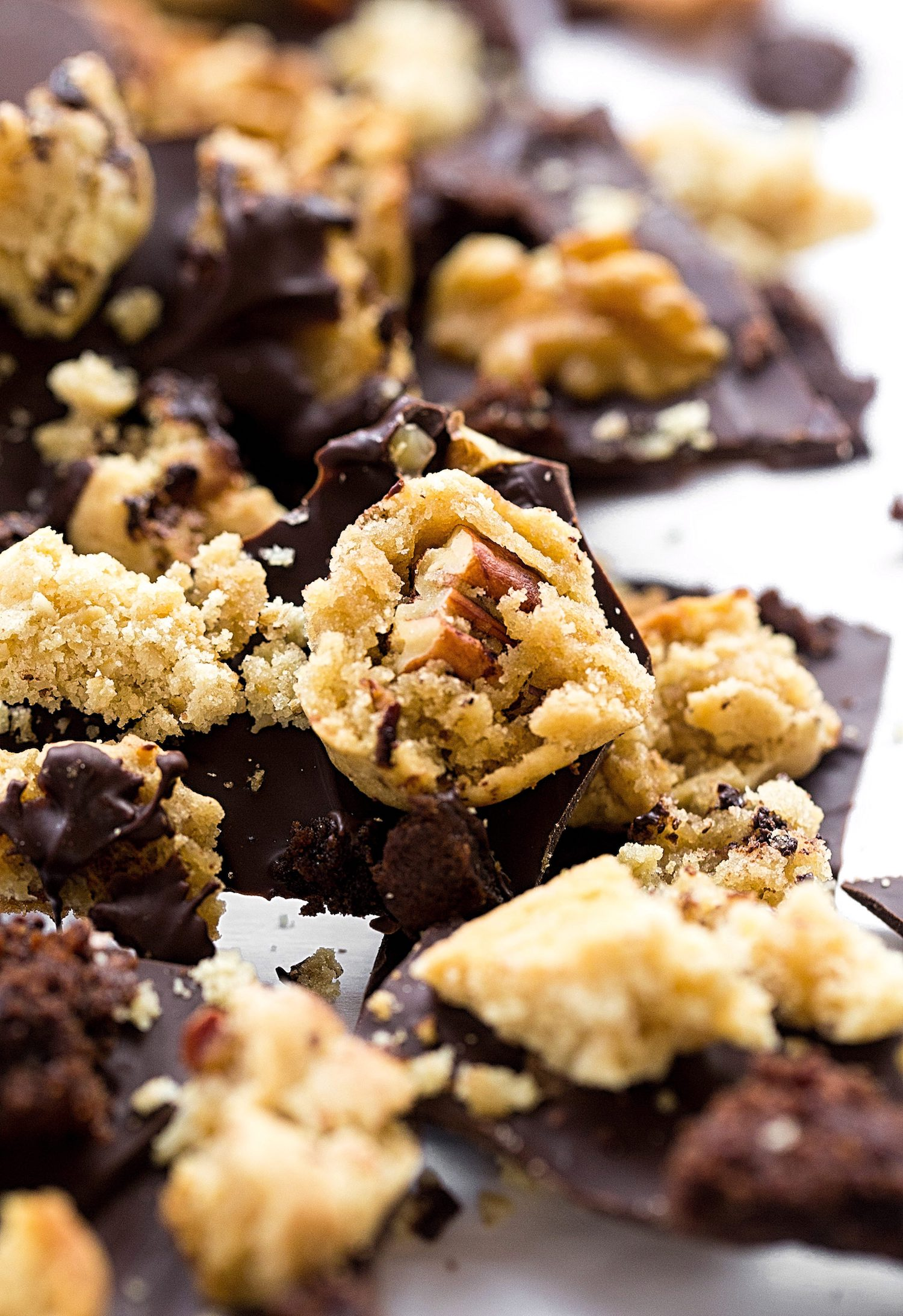 Cookie Cluster Chocolate Bark: crisp, dark chocolate bark stuffed with cookie clusters and nuts. So easy and good!   TrufflesandTrends.com