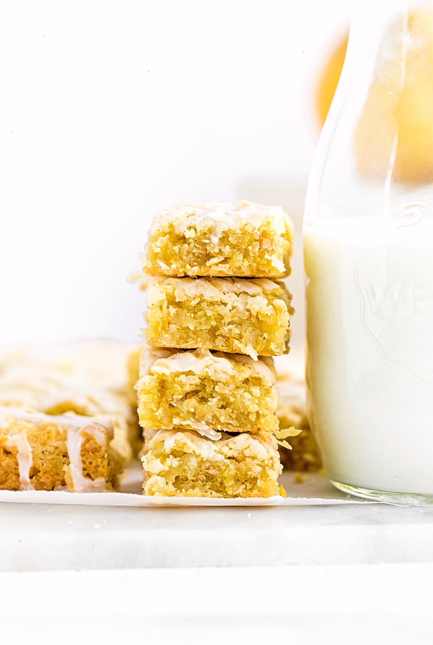Lemon Coconut Oat Blondies: soft, gooey, rich lemon blondies filled with coconut flakes and oats. Quick and easy! | TrufflesandTrends.com