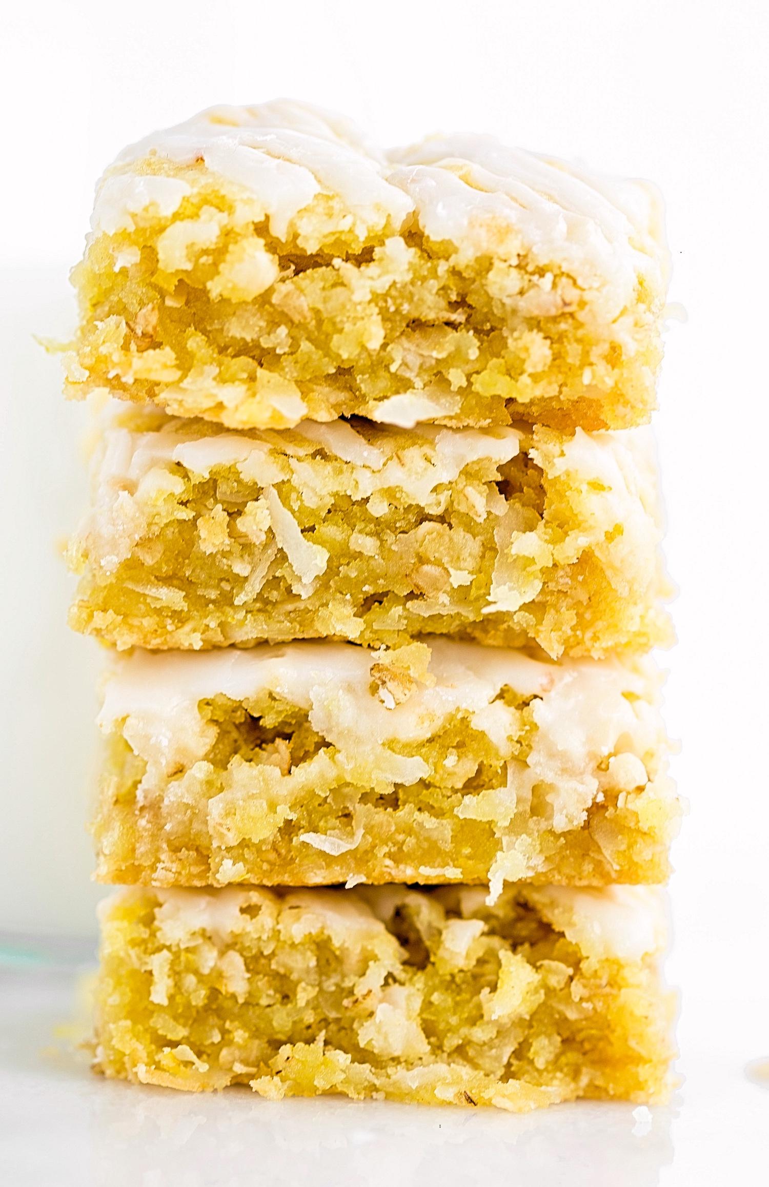 lemon oatmeal blondies 8.jpgLemon Coconut Oat Blondies: soft, gooey, rich lemon blondies filled with coconut flakes and oats. Quick and easy! | TrufflesandTrends.com