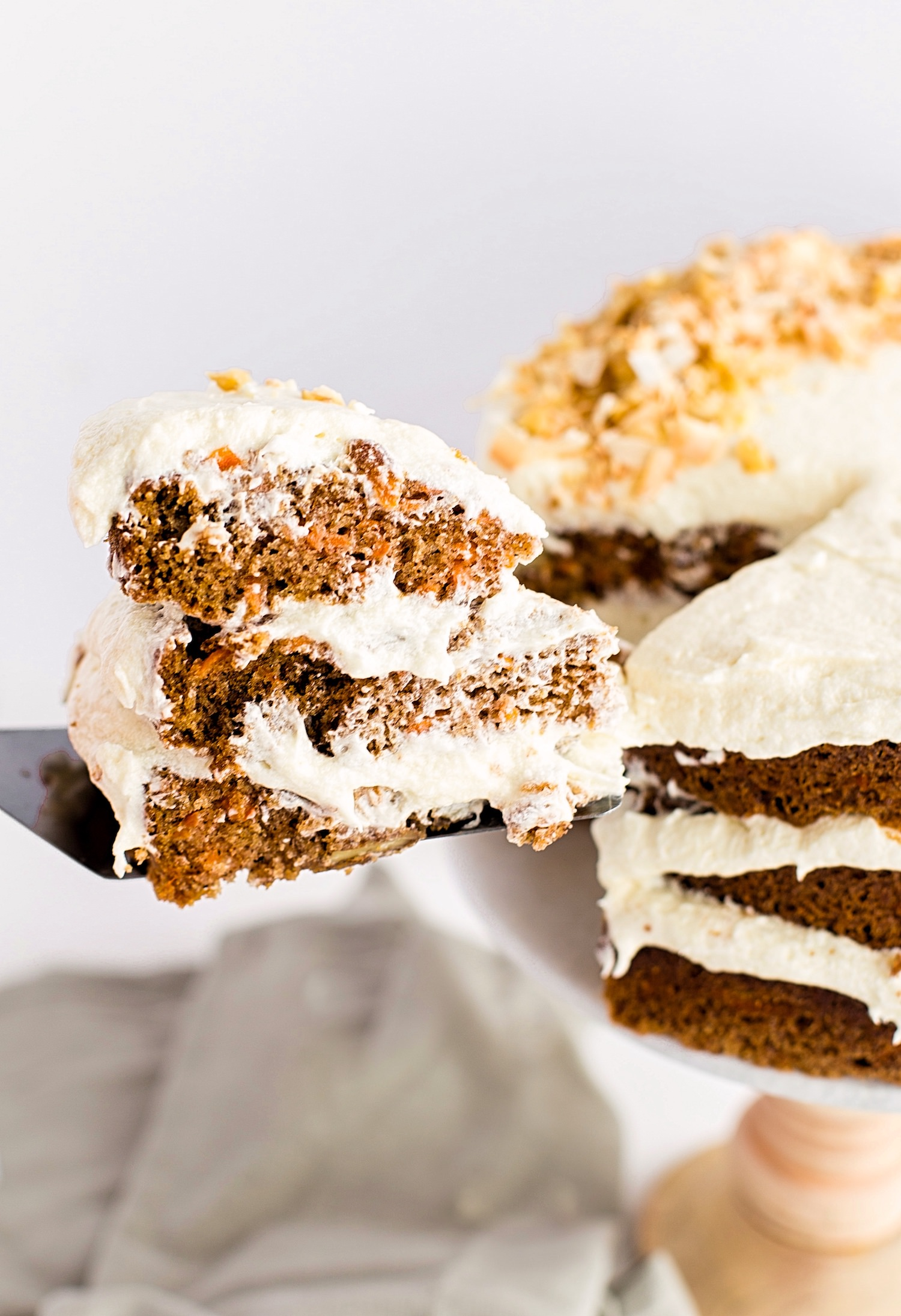 Amazing Carrot Cake with Cream Cheese Frosting: soft, moist, fluffy, spiced carrot layer cake with a creamy cream cheese frosting. | TrufflesandTrends.com