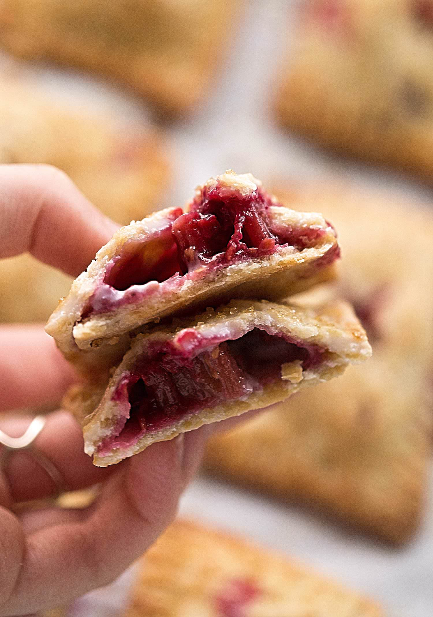 Raspberry Rhubarb Hand Pies: flaky pie dough with a tart and sweet raspberry-rhubarb filling in individual, travel-friendly, picnic-perfect form! | Trufflesandtrends.com