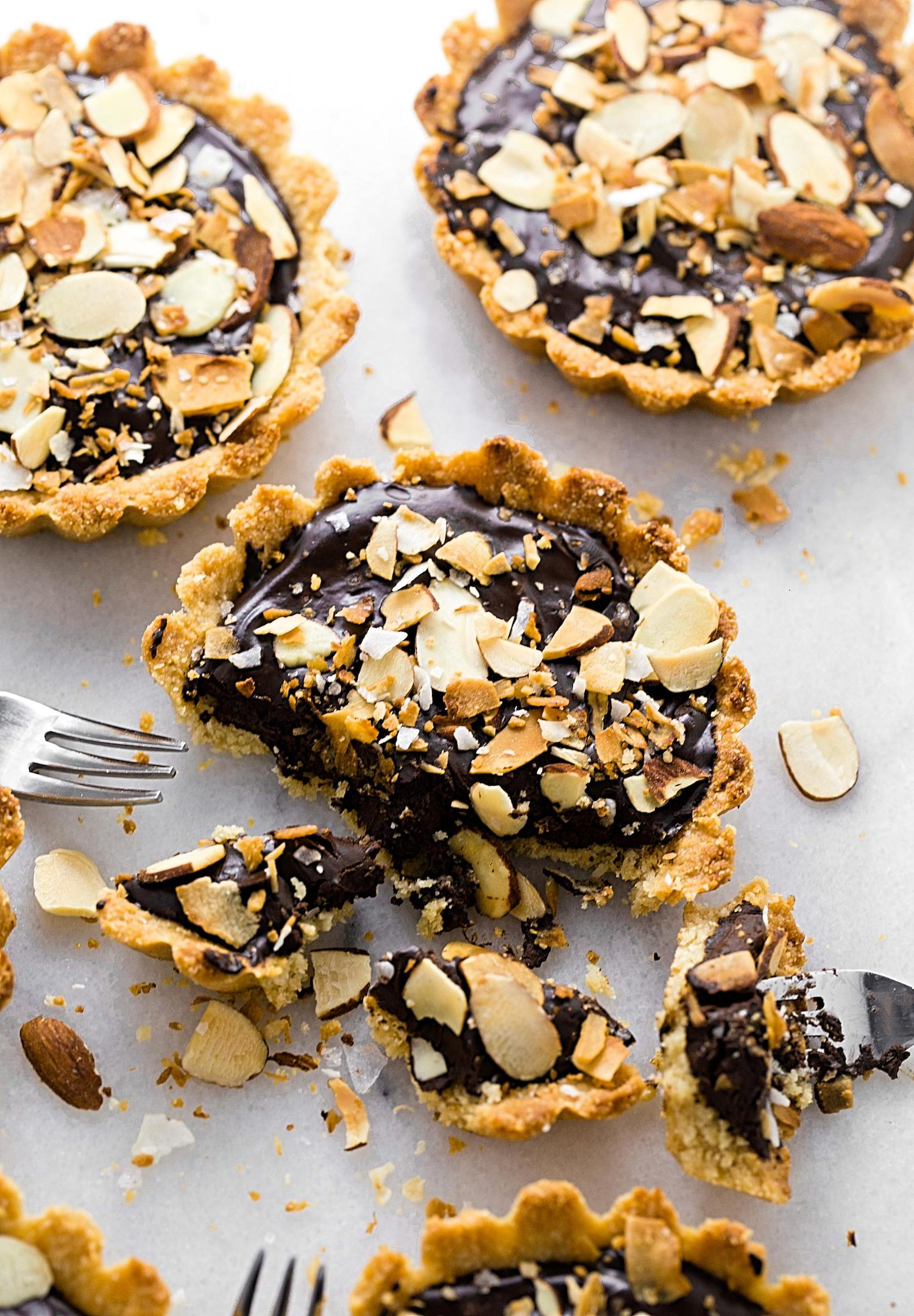 Gluten-Free Chocolate Almond Tartlets: almond flour and coconut crust filled with a creamy and rich chocolate ganache. Dairy and gluten-free! | TrufflesandTrends.com