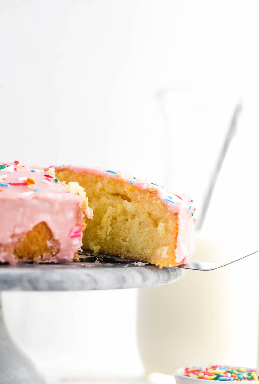 Basic Glazed Vanilla Cake: soft, fluffy, moist, dairy-free vanilla round cake with a classic vanilla glaze. Quick and easy! | TrufflesandTrends.com