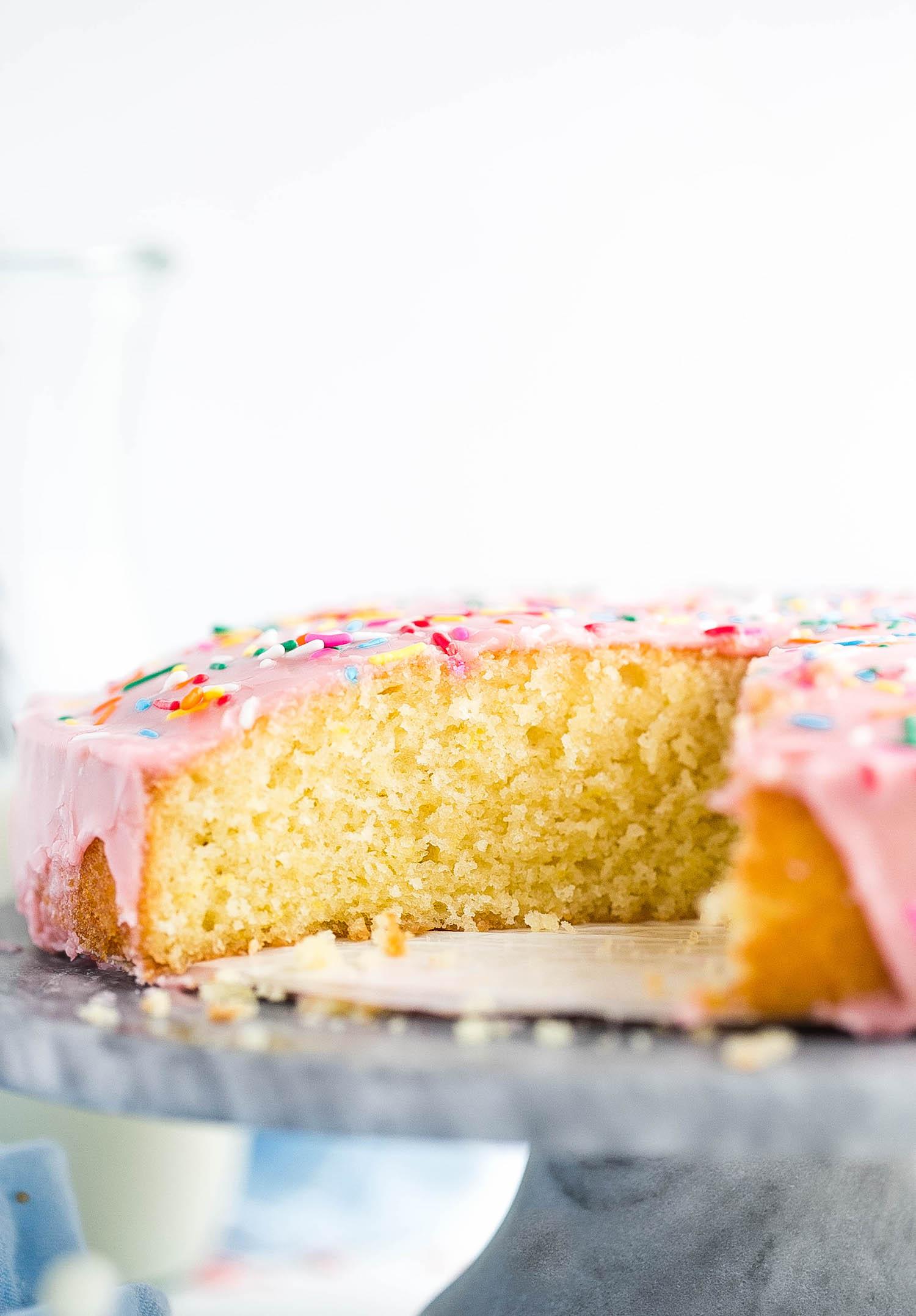 basic glazed vanilla cake 10.jpgBasic Glazed Vanilla Cake: soft, fluffy, moist, dairy-free vanilla round cake with a classic vanilla glaze. Quick and easy! | TrufflesandTrends.com