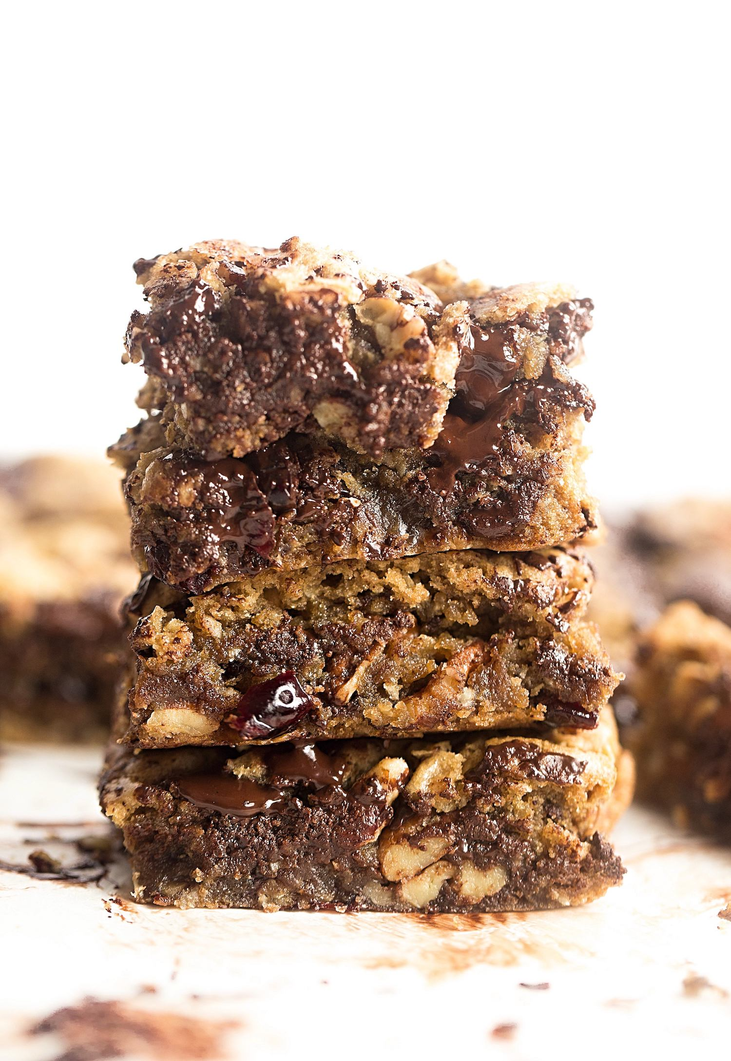 Soft and Gooey No-Butter Everything Bars: rich, one-bowl, cookie dough-like bars packed with chocolate chunks, oats, dried fruit and nuts. | TrufflesandTrends.com