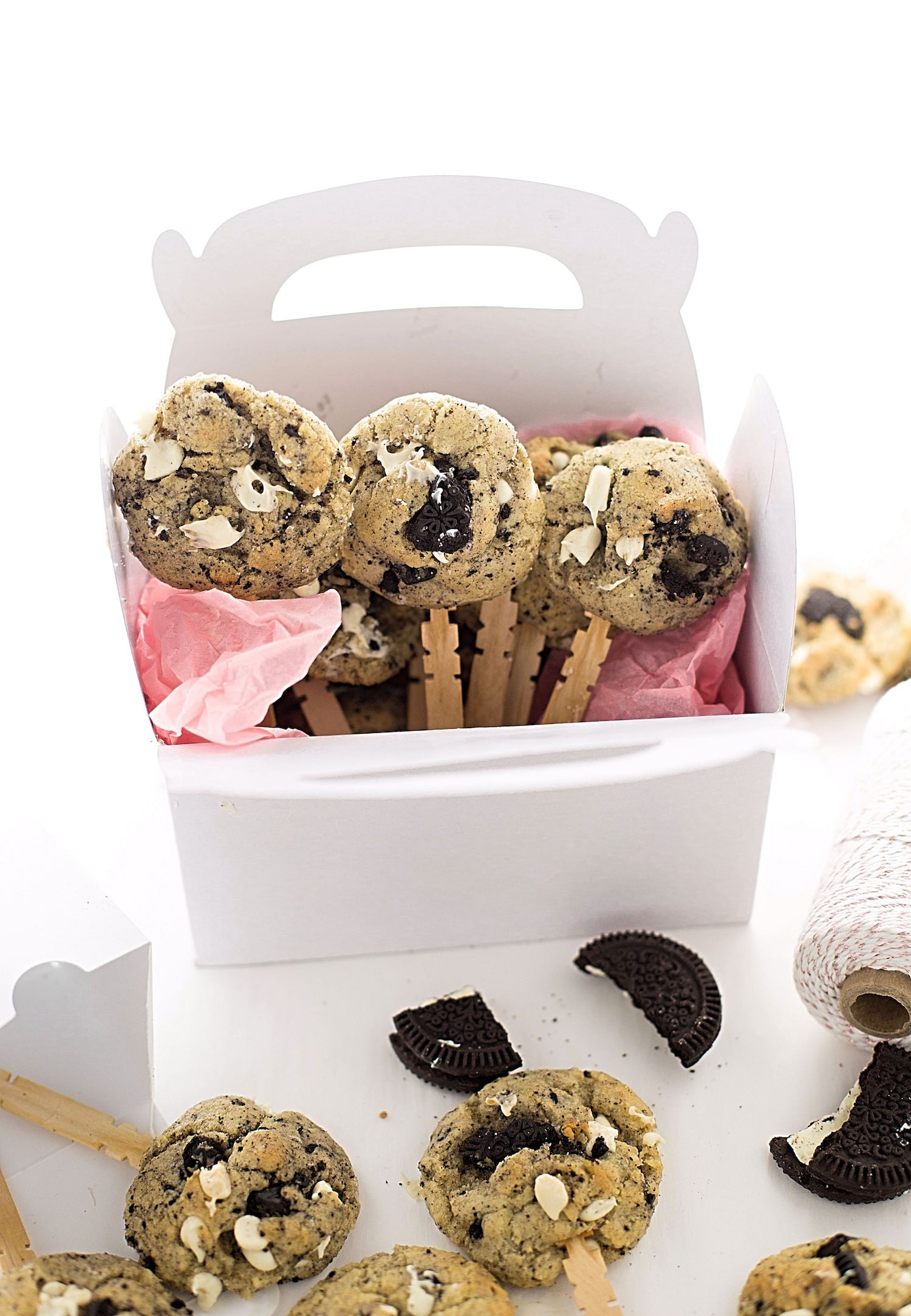 Cookies and Cream Cookie Pops: dairy-free, soft and chewy cookies packed with white chocolate chips and crushed Oreo cookies, attached to popsicle sticks!   TrufflesandTrends.com