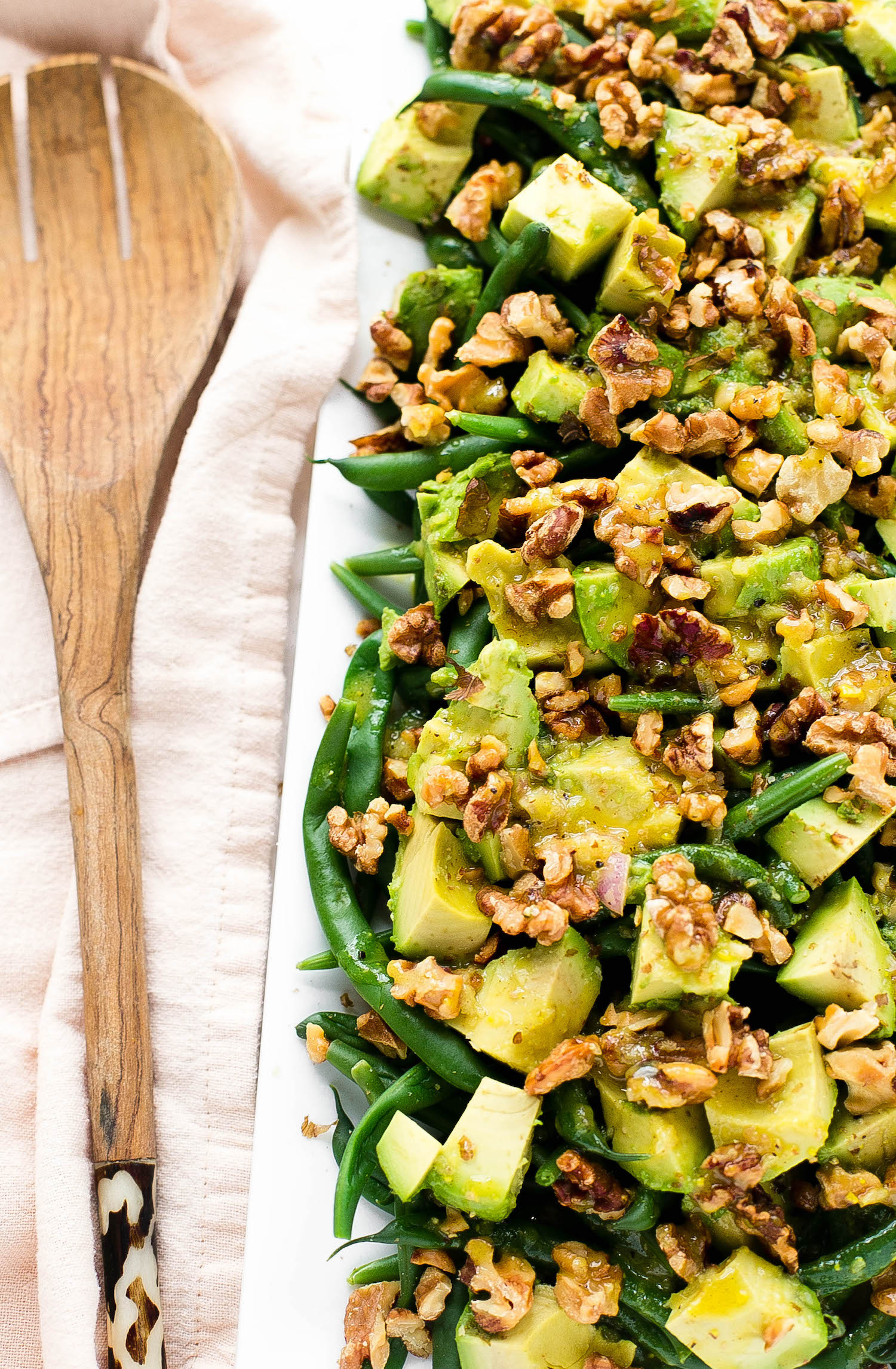 Honey Dijon Avocado Green Beans: crisp green beans with cubed avocado and toasted walnuts, tossed in a honey Dijon dressing.   TrufflesandTrends.com