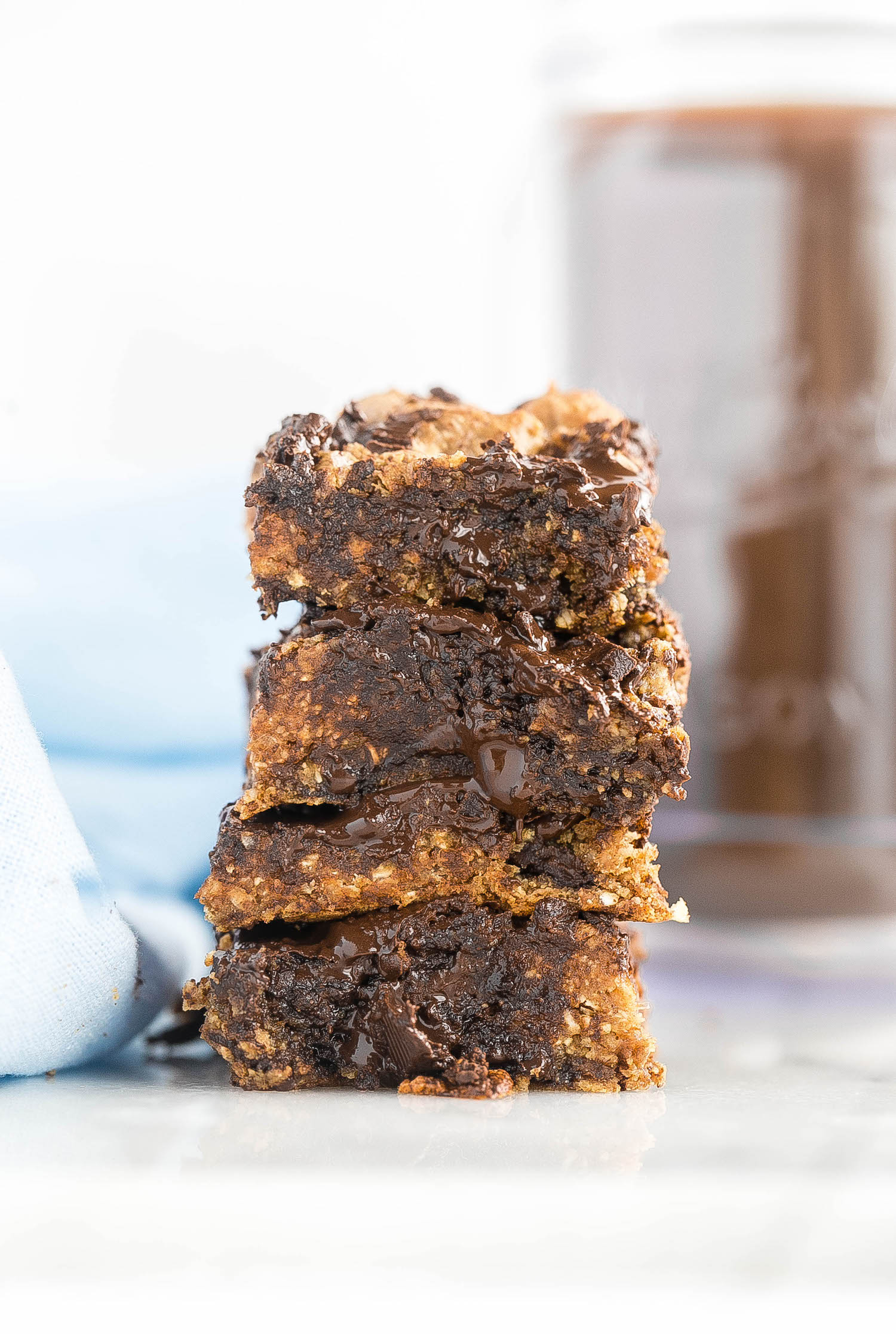 Wholesome Almond Butter Oat Chocolate Chip Bars: soft, gooey, rich flourless bars made with dates, oats, almond butter, and chocolate chunks. Dairy and refined sugar free! | TrufflesandTrends.com
