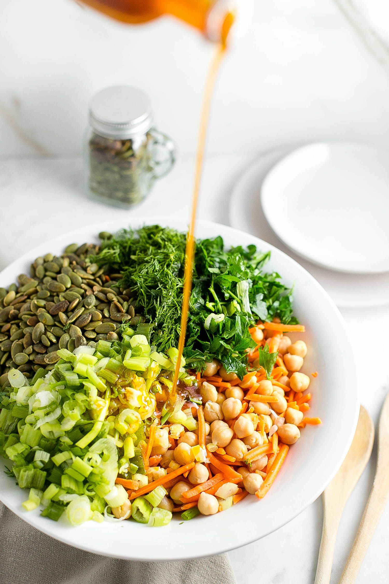 Chickpea Carrot Herb Salad: wholesome, flavorful salad with chickpeas, carrots, scallions, fresh herbs, toasted pumpkin seeds, and a tangy olive oil dressing. | TrufflesandTrends.com