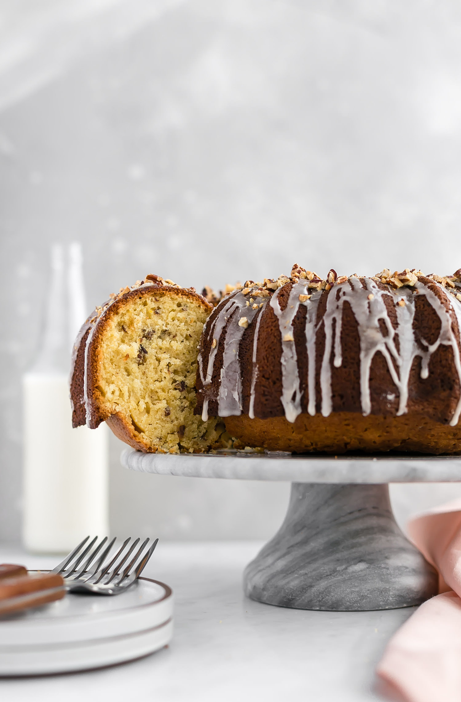 Brown Sugar Toasted Pecan Bundt Cake: soft, tender, flavor-packed Bundt cake with toasted, chopped pecans and a cinnamon glaze. Dairy-free! | TrufflesandTrends.com