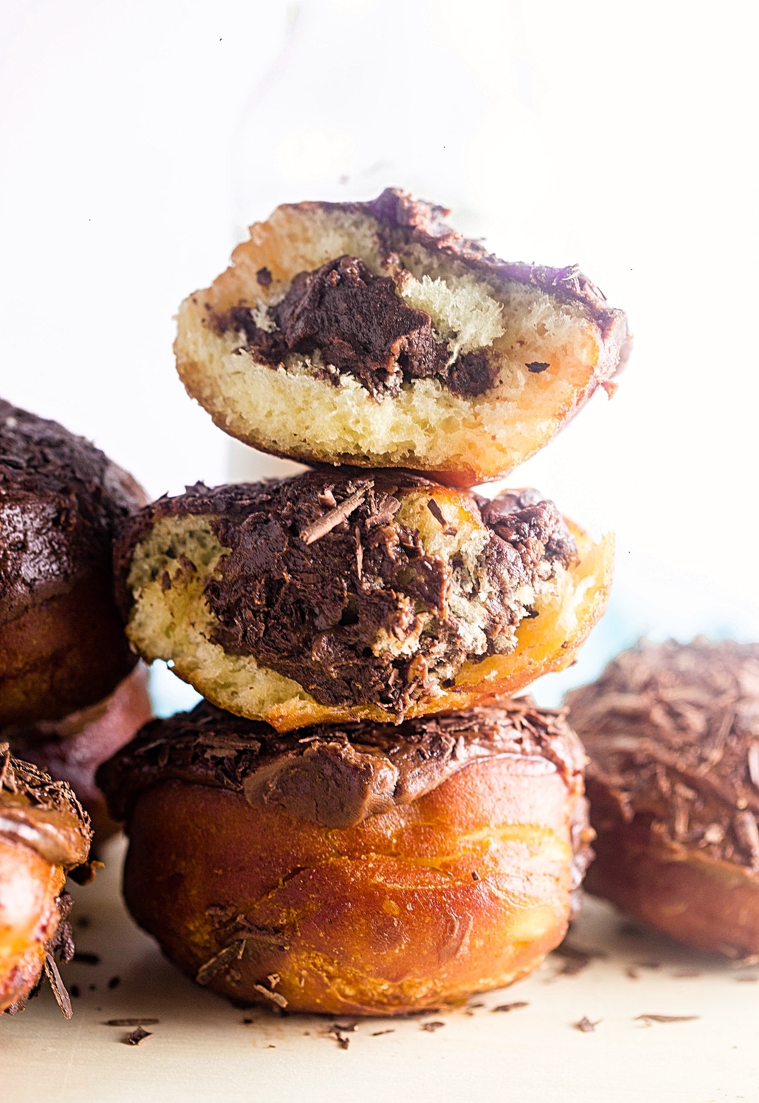Fried Chocolate Explosion Donuts: perfect fried donuts filled with a creamy chocolate custard, topped with a rich chocolate glaze, and garnished with chocolate shavings. | TrufflesandTrends.com