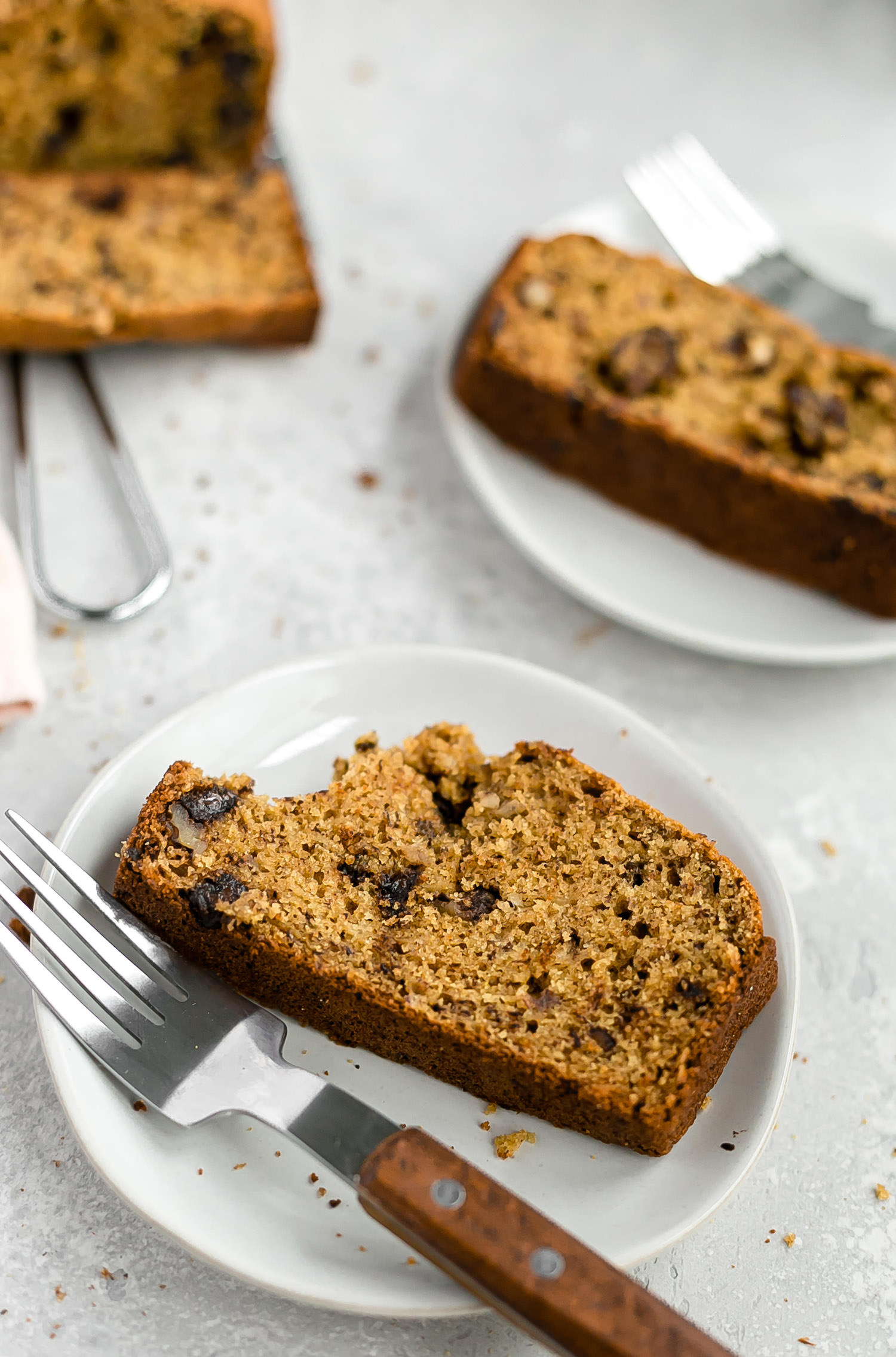 Wholesome Maple Chocolate Chip Walnut Banana Bread: soft, moist banana bread packed with chocolate chips and walnuts. Whole grain and refined sugar free!   TrufflesandTrends.com