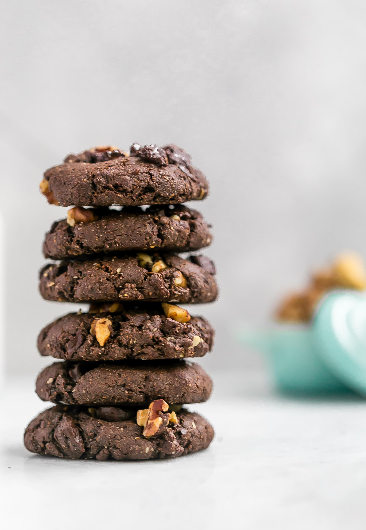 Gluten-Free Double Chocolate Walnut Cookies: chewy, rich, dense cookies full of rich chocolate flavor, melty chocolate chunks, and walnuts. Dairy and refined sugar free! | TrufflesandTrends.com